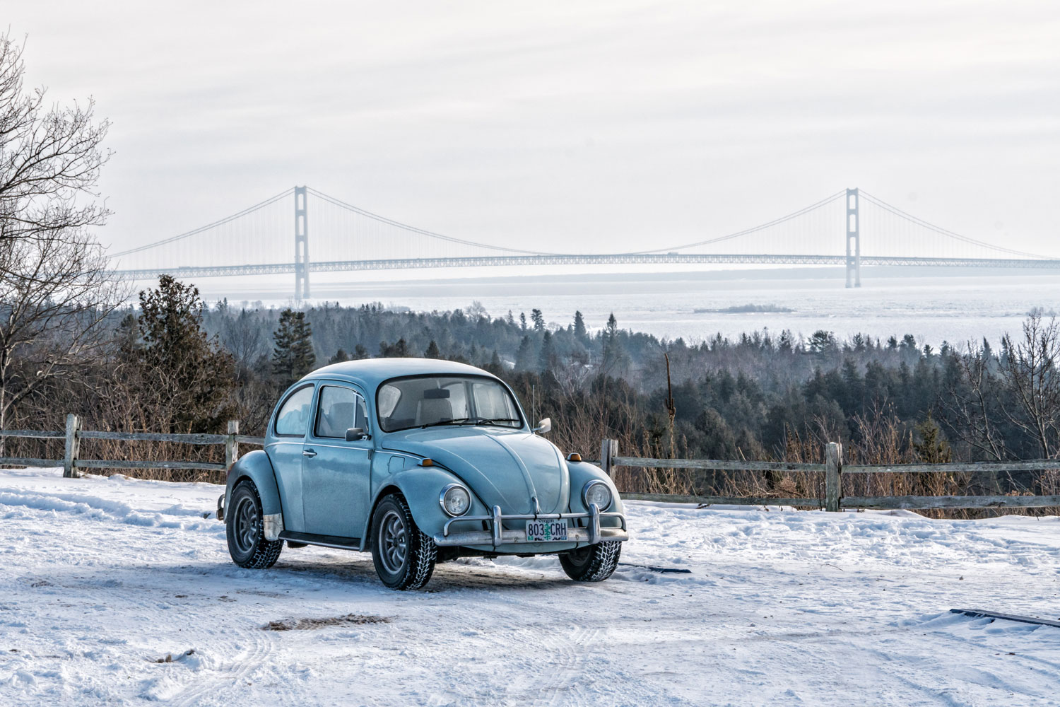 VW Beetle in front of the Mackinac Bridge