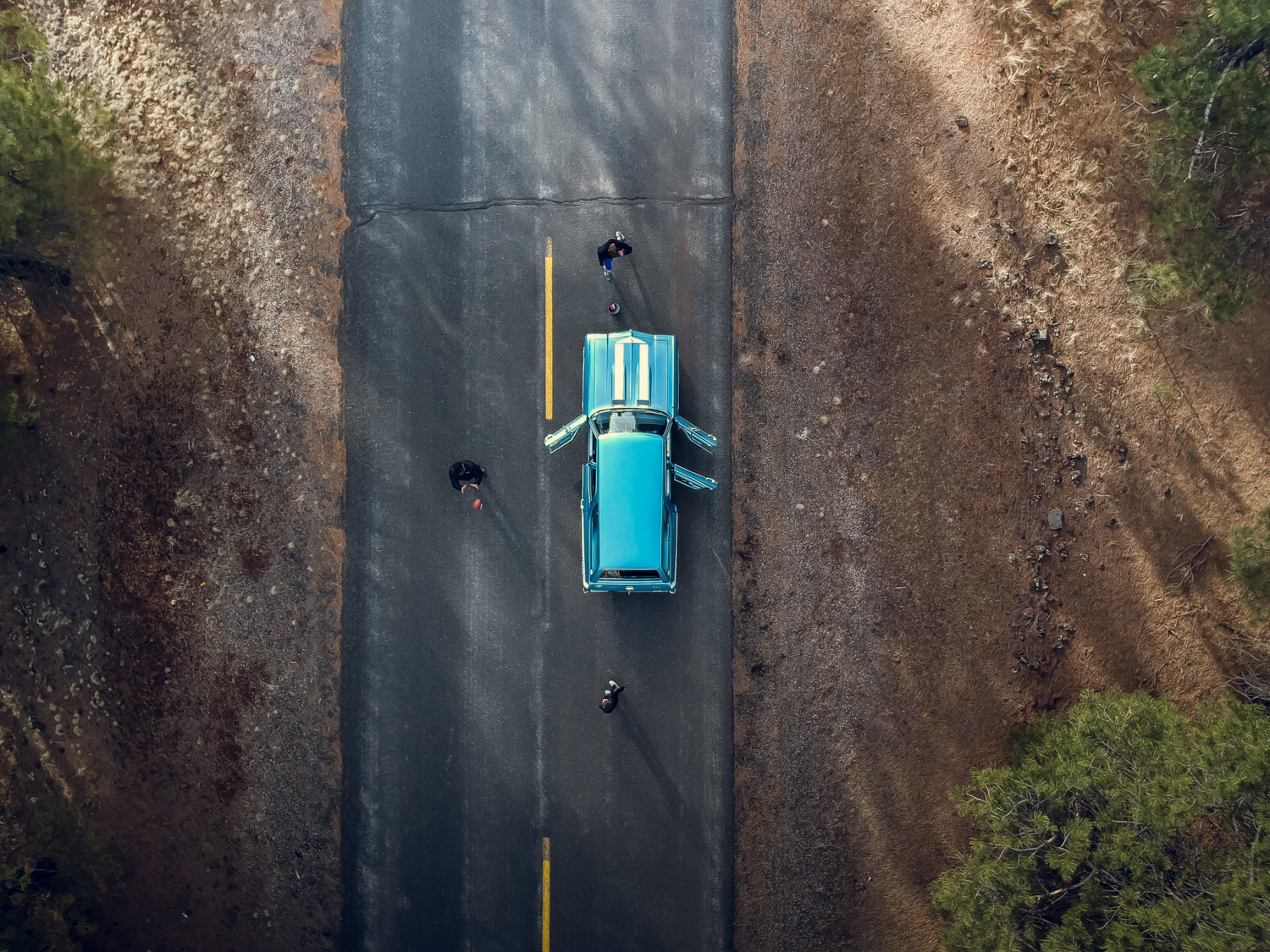 Blue chevelle from above drone doors open