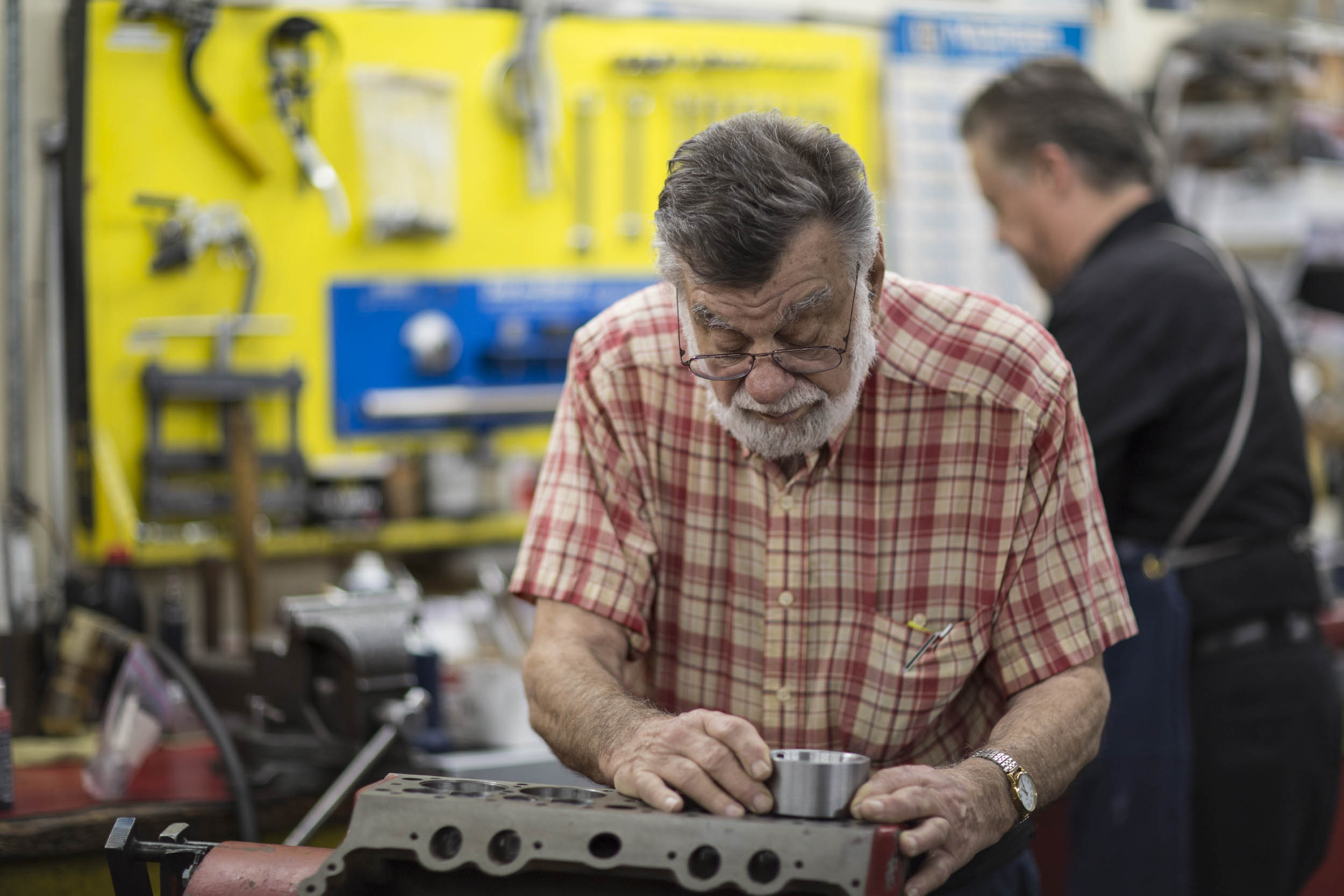 Larry Ofria installs a piston in a Ford V8-60, the 136- cubic-inch sibling of the famous Ford flathead. Rare to see outside a museum, it's a neat little engine and was a favorite among midget racers in the 1930s.