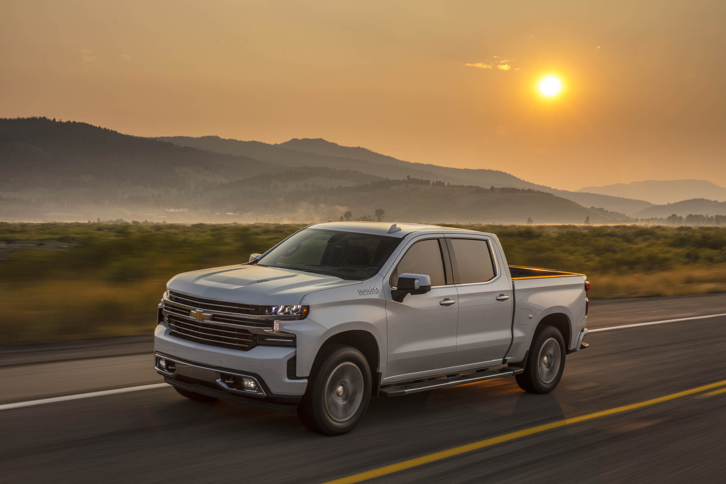 2019 chevrolet silverado high country on road at sunset