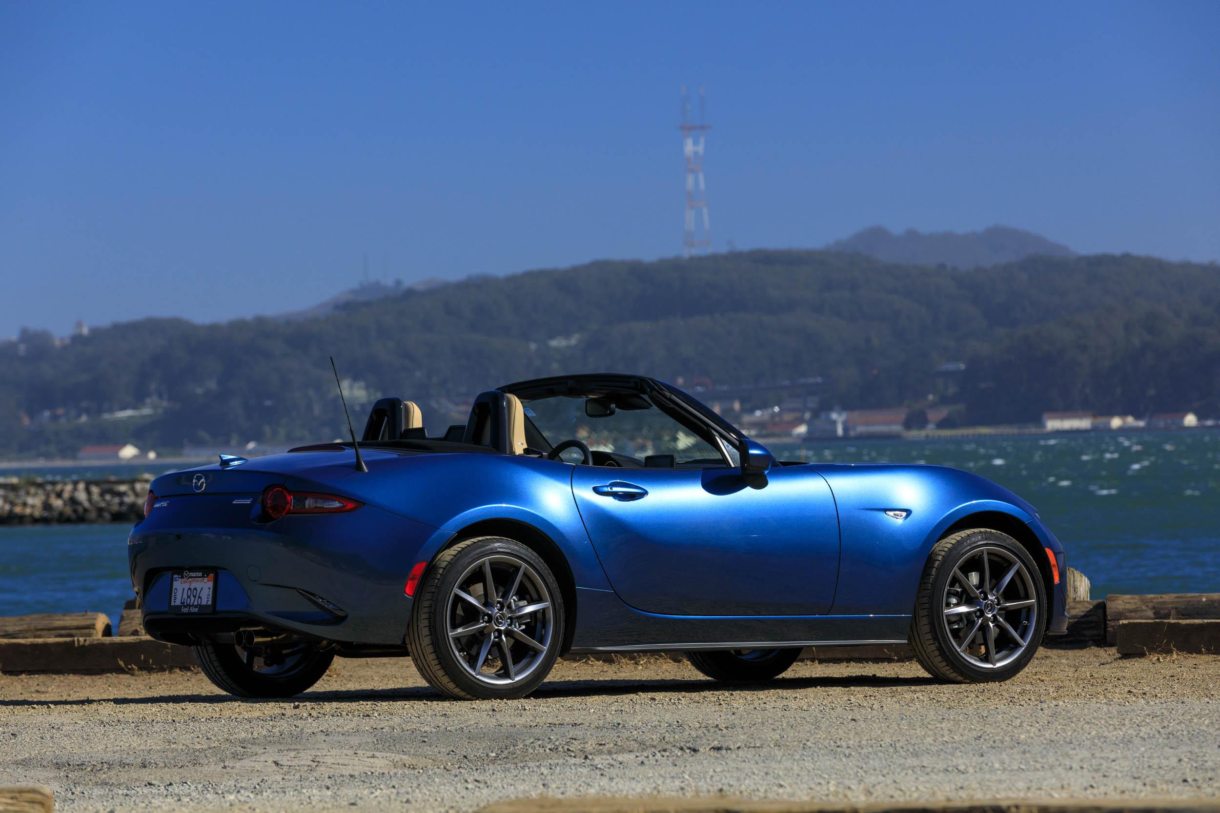 blue 2019 Mazda MX-5 Miata Roadster rear 3/4 on the coast