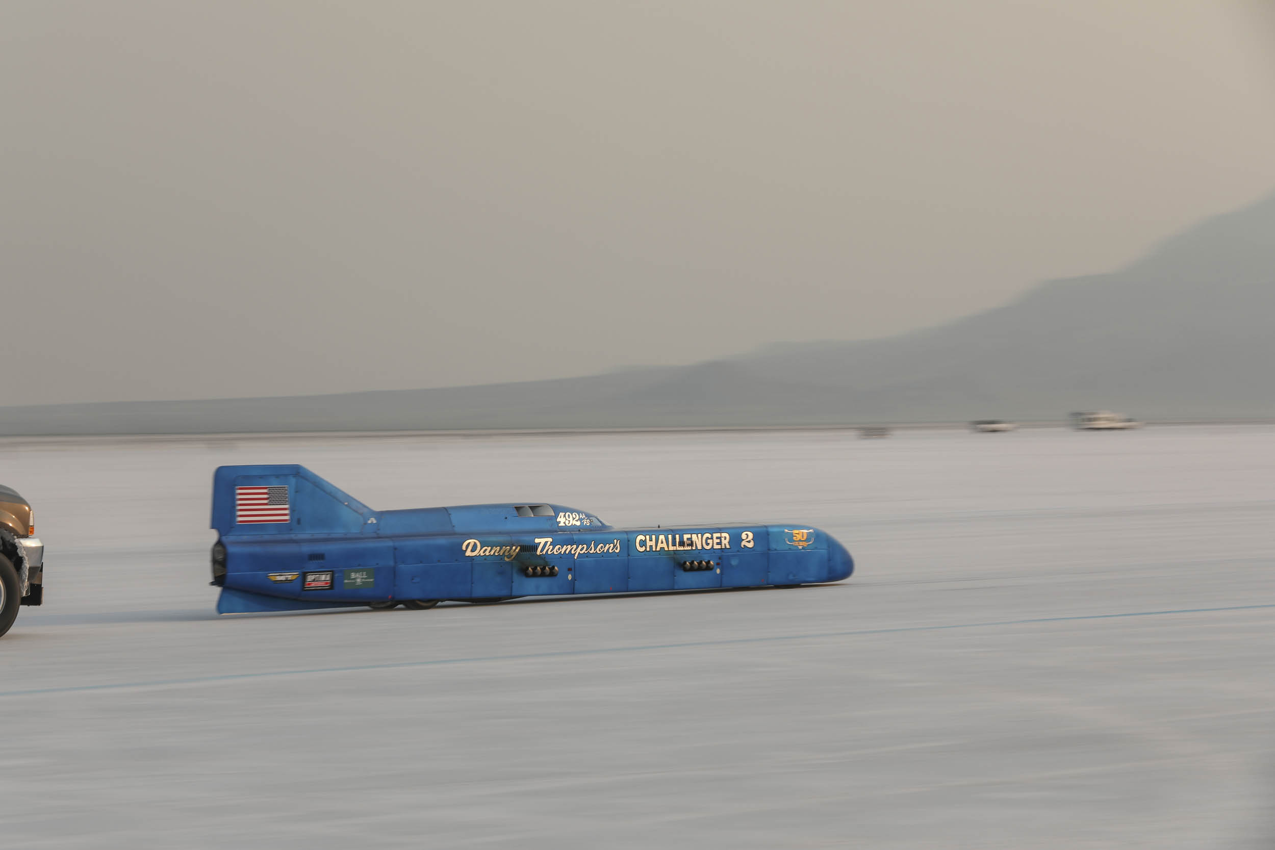 Danny Thompson increased his previous record, set in 2016, to claim the Speed Week mark for AA Fuel Streamliners at 448.757 mph, the fastest for a piston-powered car at Speed Week.
