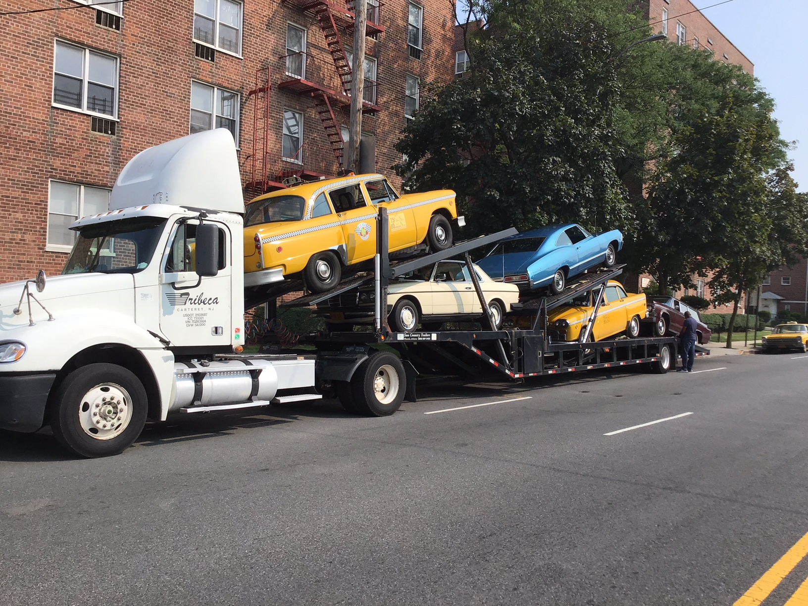 Cars for The Deuce, Season 2 loaded up for delivery to the set.