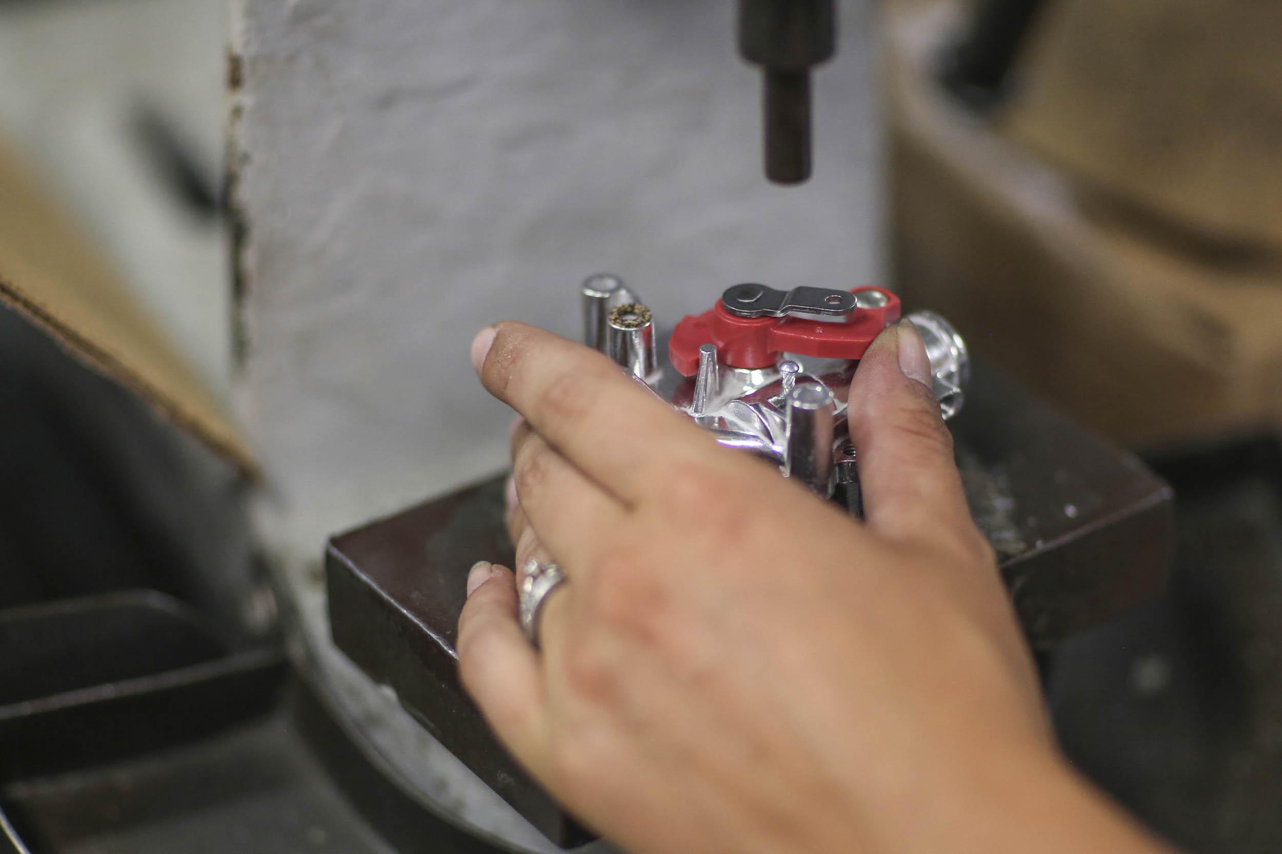 Holley four-barrel carburetor shaft pressed into place