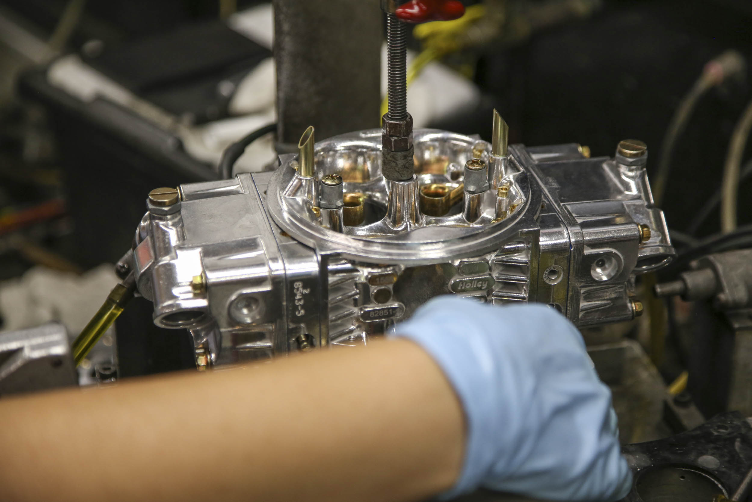 Once finished, the carburetor's first stop is a test bench, where solvent is pumped through it and air is drawn over the boosters to simulate a running engine