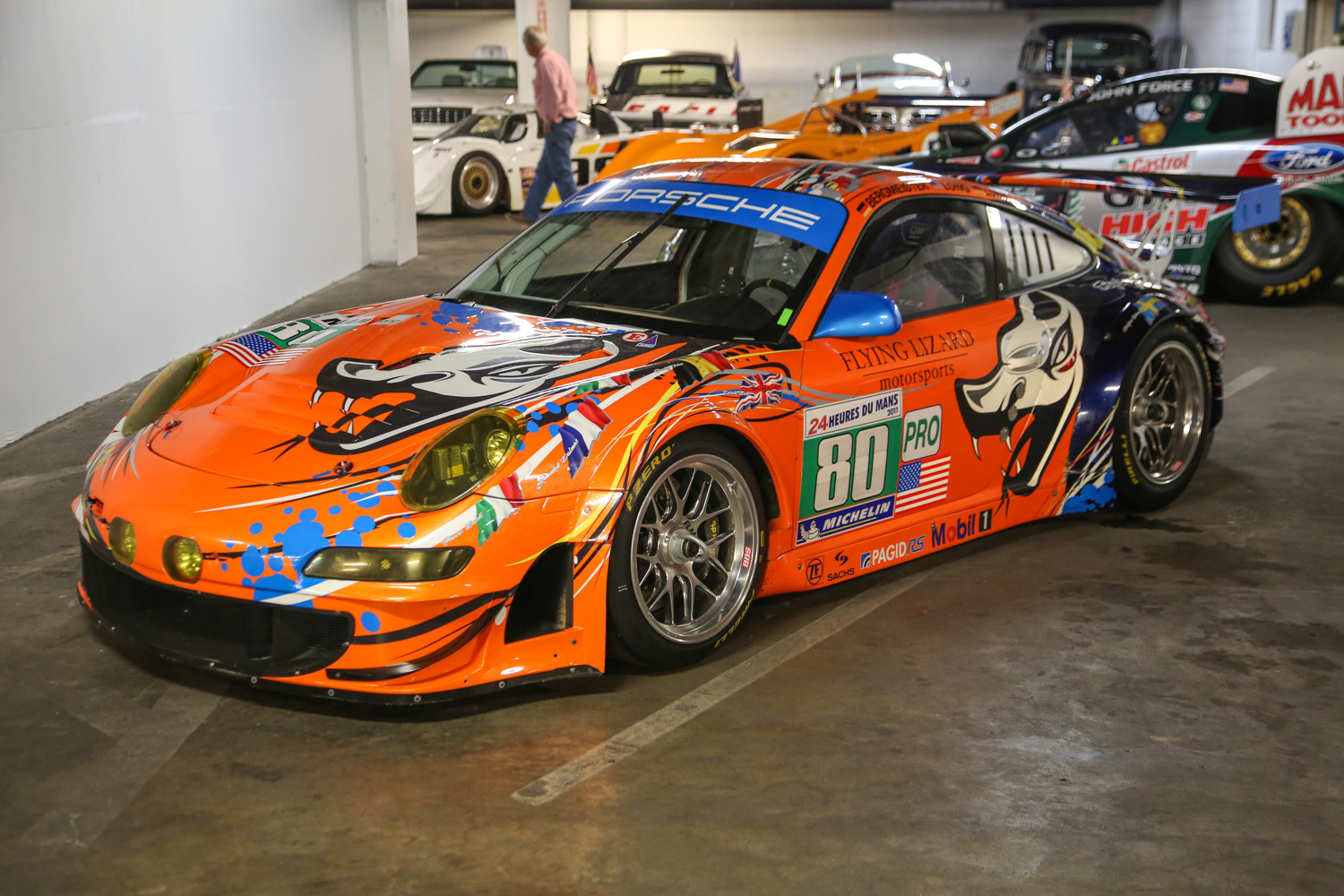 Built as an homage to Porsche's success at Le Mans, this 997 GT3 RSR wears Flying Lizard livery and has been signed by many of the Porsche drivers who drove to victory in class at Le Mans.
