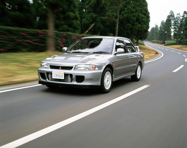 Mitsubishi Lancer Evolution II silver 3/4 front on road