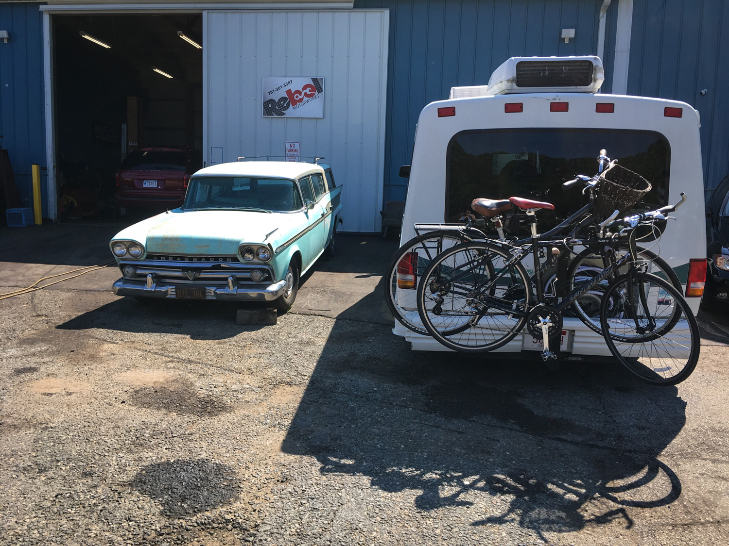 The Rialta in front of Rebel Motor Works in Plymouth, Massachusetts. That '59 AMC Ambassador wagon was pretty cool too.