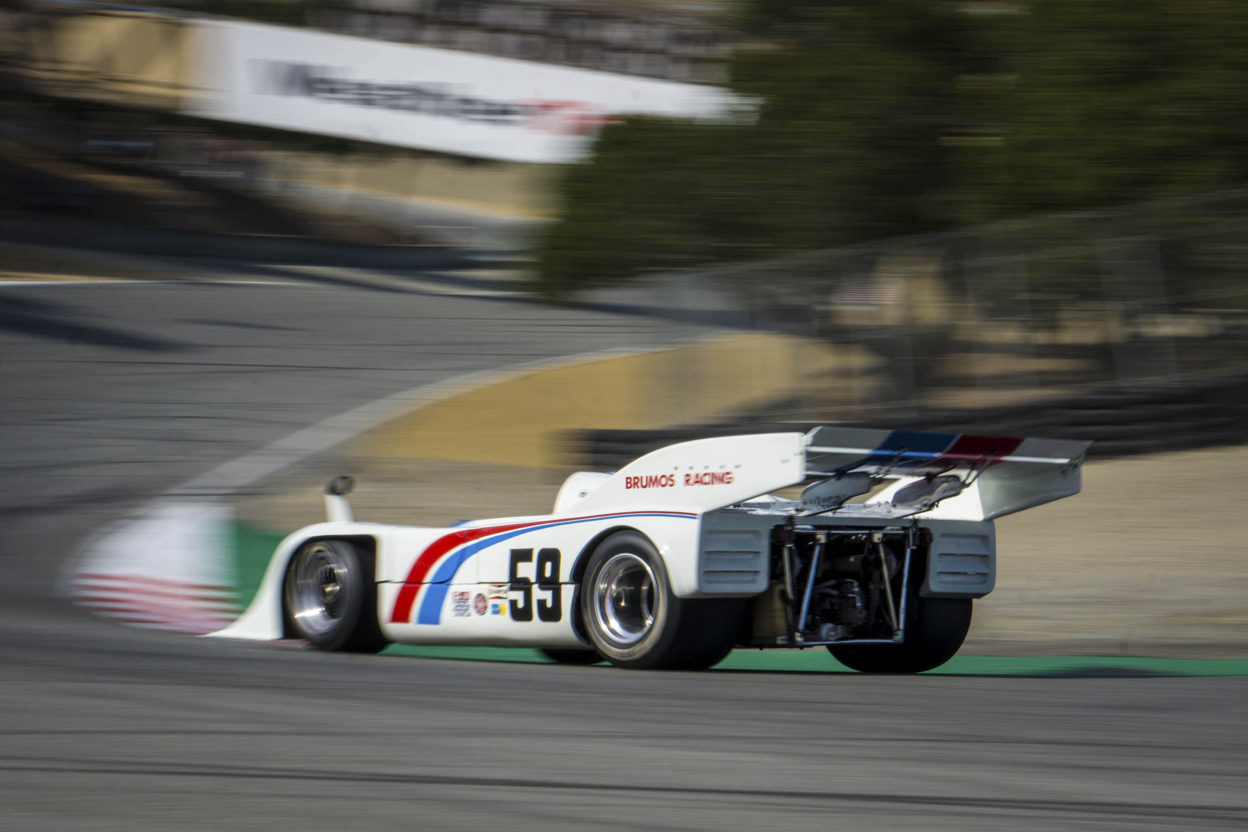 """Hurley Haywood was a chipper 23-year-old when he raced in the Brumos Porsche 917/10... 1250 horsepower… feet tickling the front nose of the car. """"It was a real handful to get your arms around that beast,"""" Haywood recalls, adding, """"I had to be nuts to drive that car."""" Here, the Brumos beast careens through the Corkscrew."""