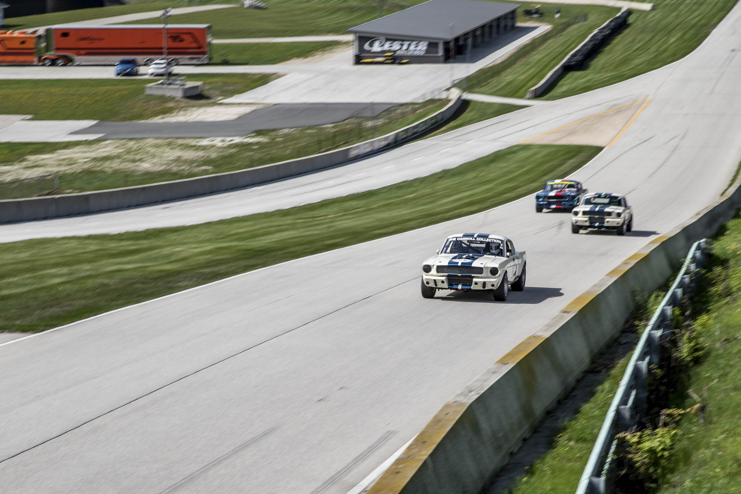A trio of unmuffled Mustangs thunders up the main straight. Standing trackside leads one to wonder if the Ford small-block has the most soulful wail of any V-8.