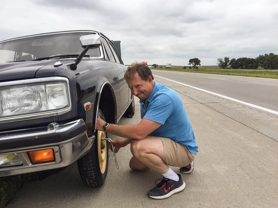 Toyota Century changing a tire
