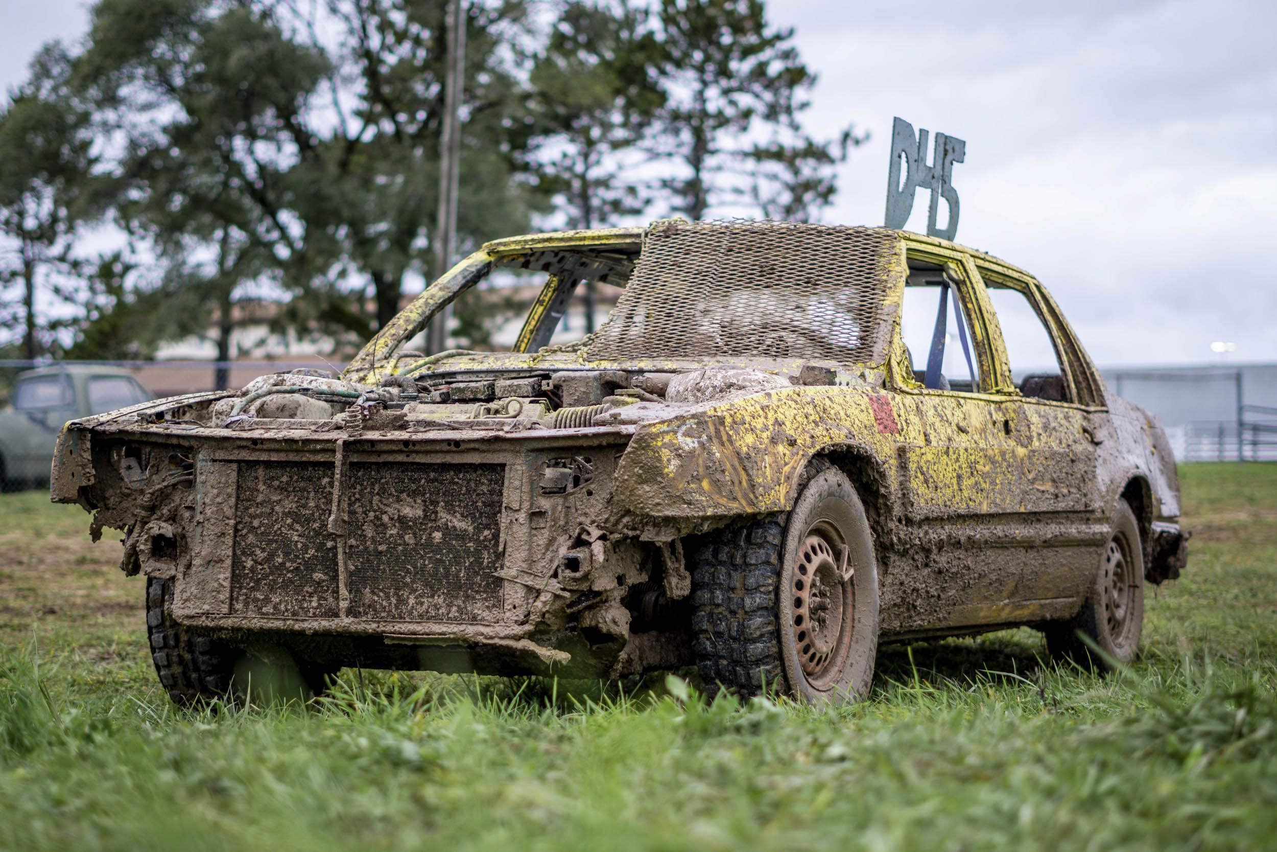 mud covered demolition derby car