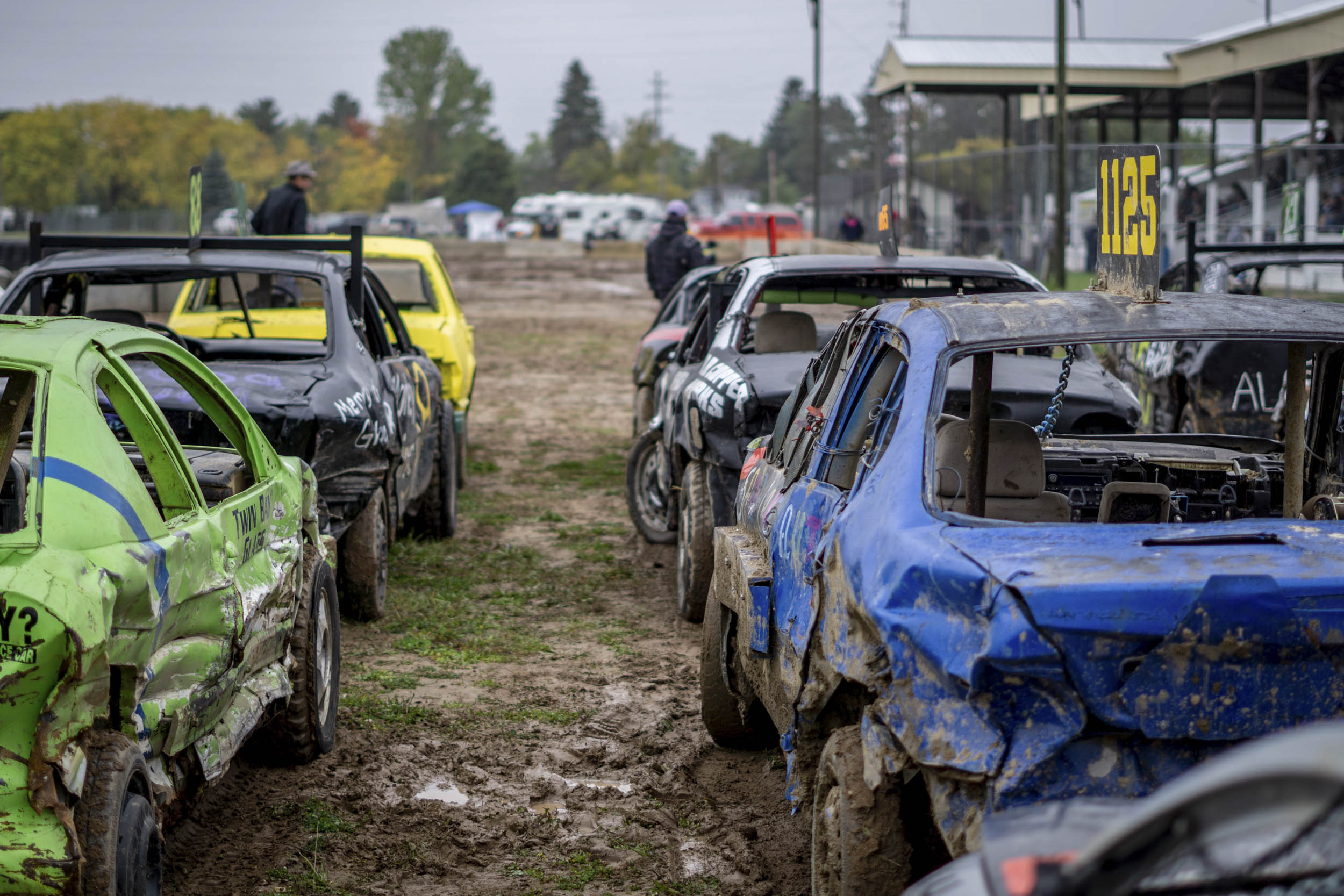 demolition derby cars ready to go on the track