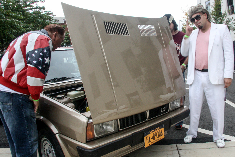 Don Johnson and a patriot check out an '82 Lancia Delta.