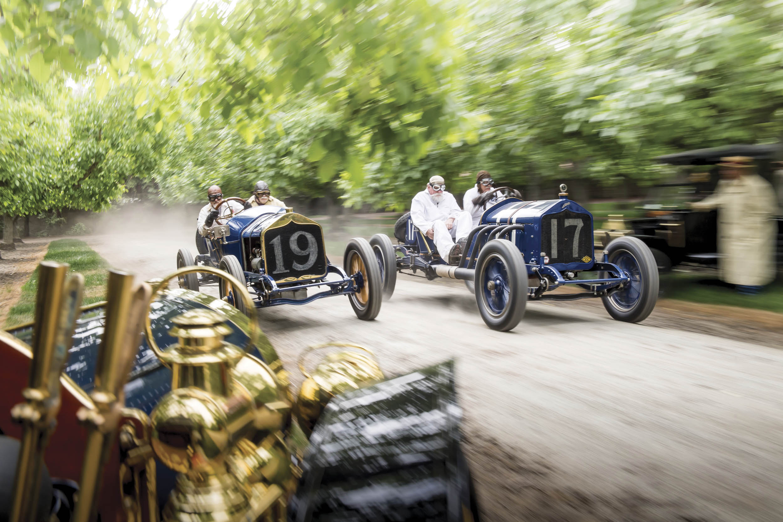 Blain's hometown of Visalia, California, hosted races back in the day, here re-created in a walnut orchard with a duo of century-old Nationals, a 1905 National (foreground), and a Ford Model T.