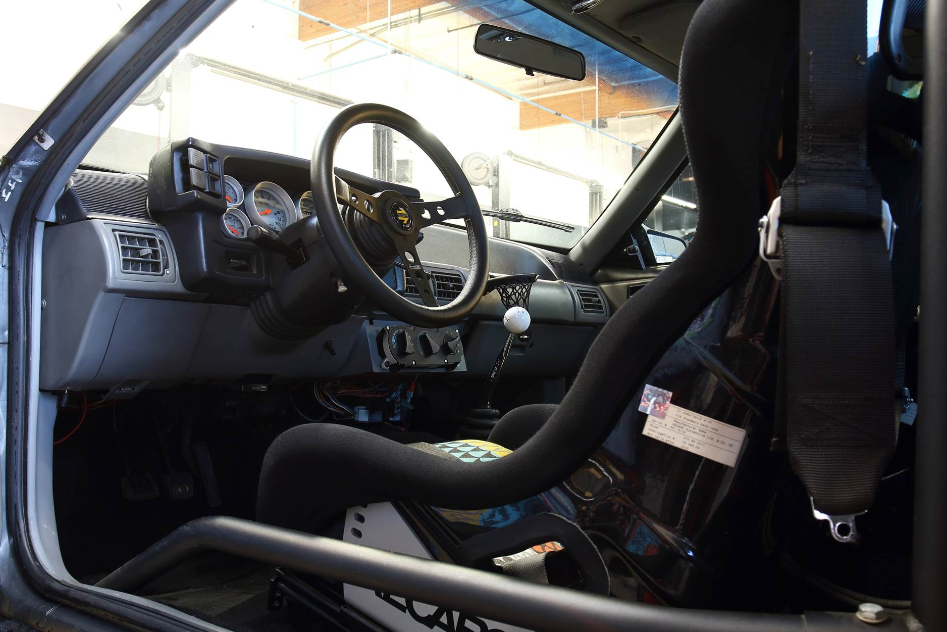 Matt Farah Smoking Tire Fox Body Bring a Trailer interior door open