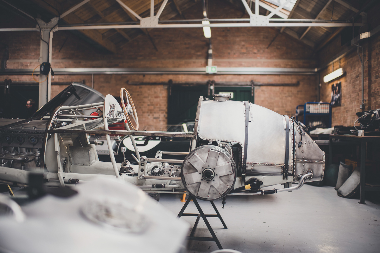 In 2013, the British government handed a bucket of keys to Bicester's new operators and walked away. Some 35 companies now occupy the restored airbase workshops, including specialists who restore anything from a D-type Jag to a single-seater Maserati.