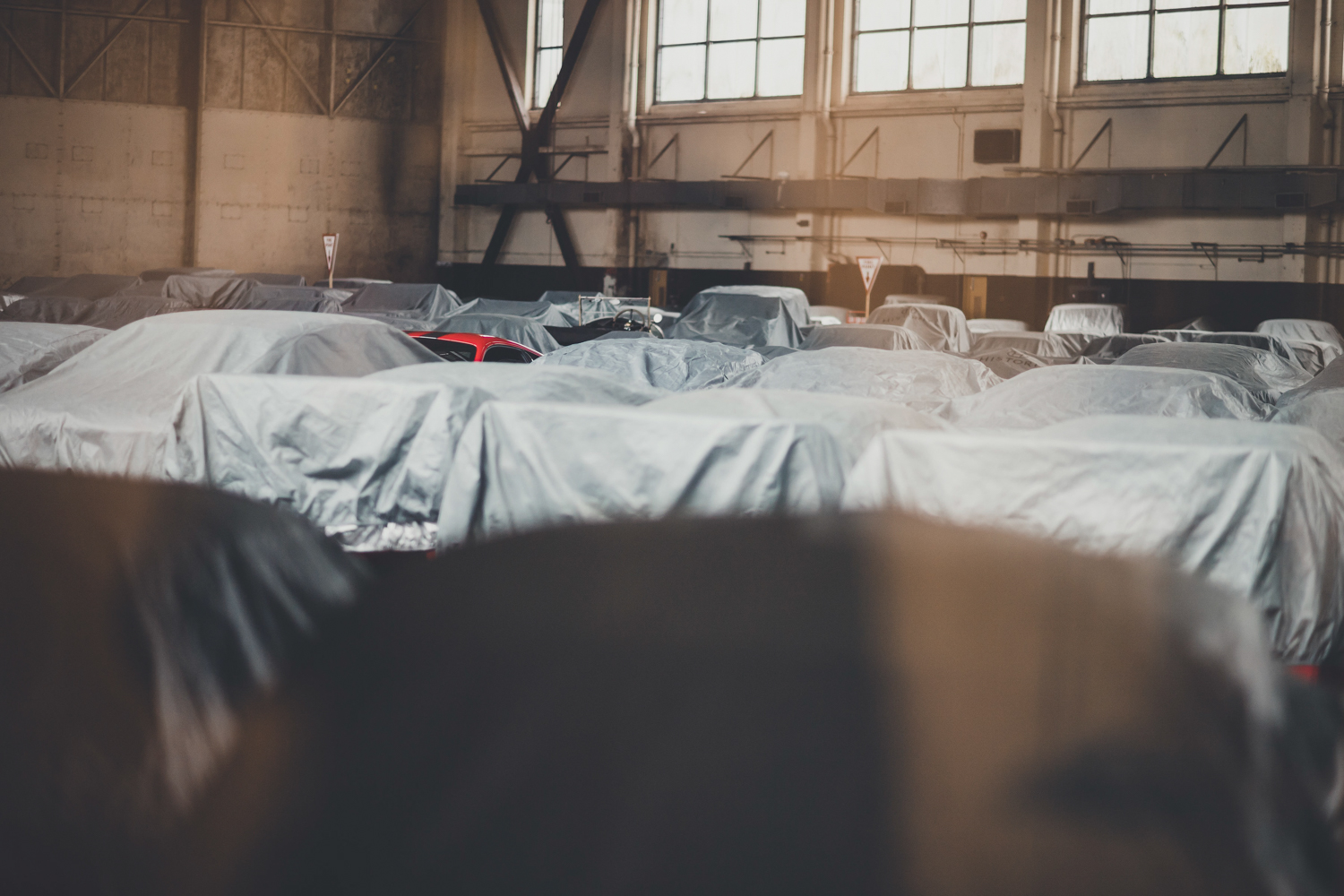 Stored cars sleep in one of the base's two huge main hangars, which have thick concrete floors and 36-foot- high ceilings. Climate-controlled storage starts at about  alt=