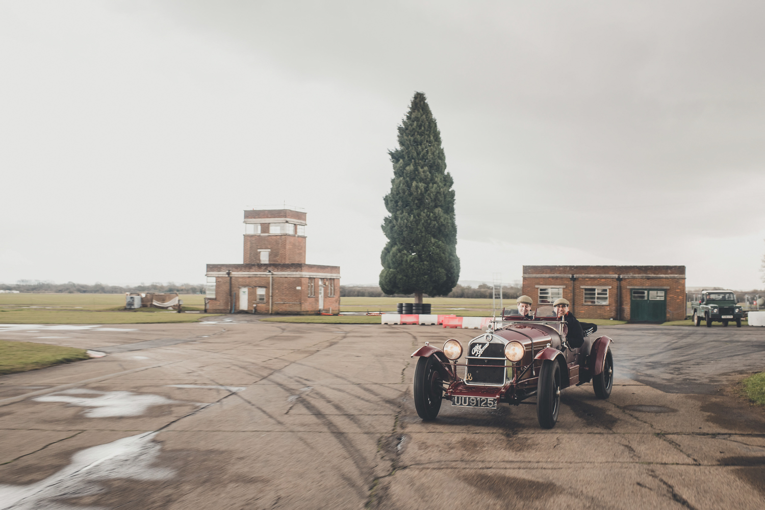 The first aircraft to land on Bicester's grass field came in 1914. Today, the former RAF Bicester is an old-car playground that includes a test track where on-site car dealer Robert Glover (left) demonstrates a 1929 Alfa 6C 1750 Super Sports about to go to the Mille Miglia.
