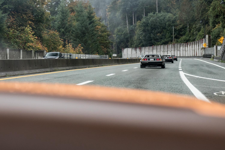DeLorean DMC-12 vs Bricklin on road behind