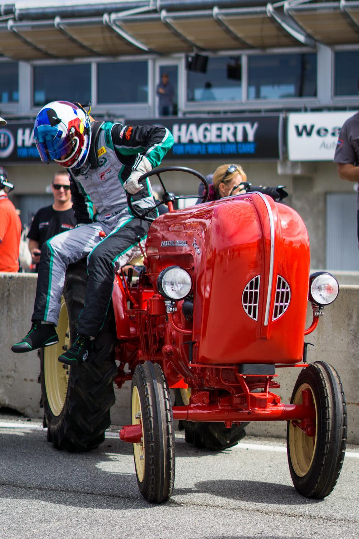 Porsche Rennsport Tractor race driver dismount