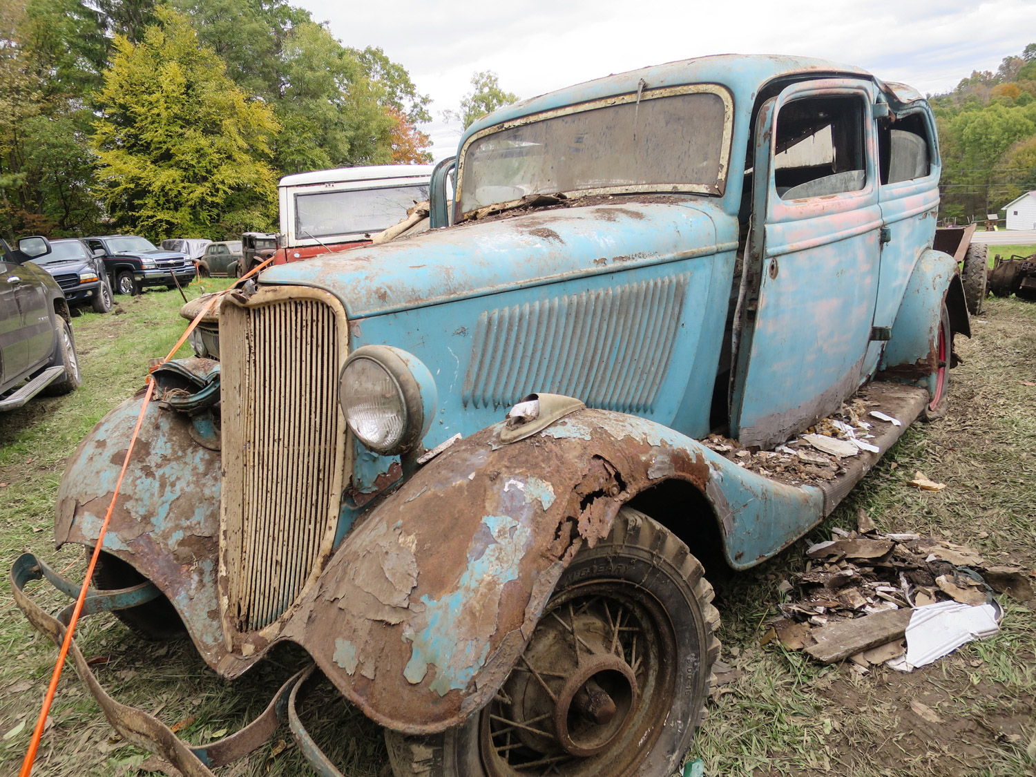 1934 ford coupe blue 3/4 barn collapse