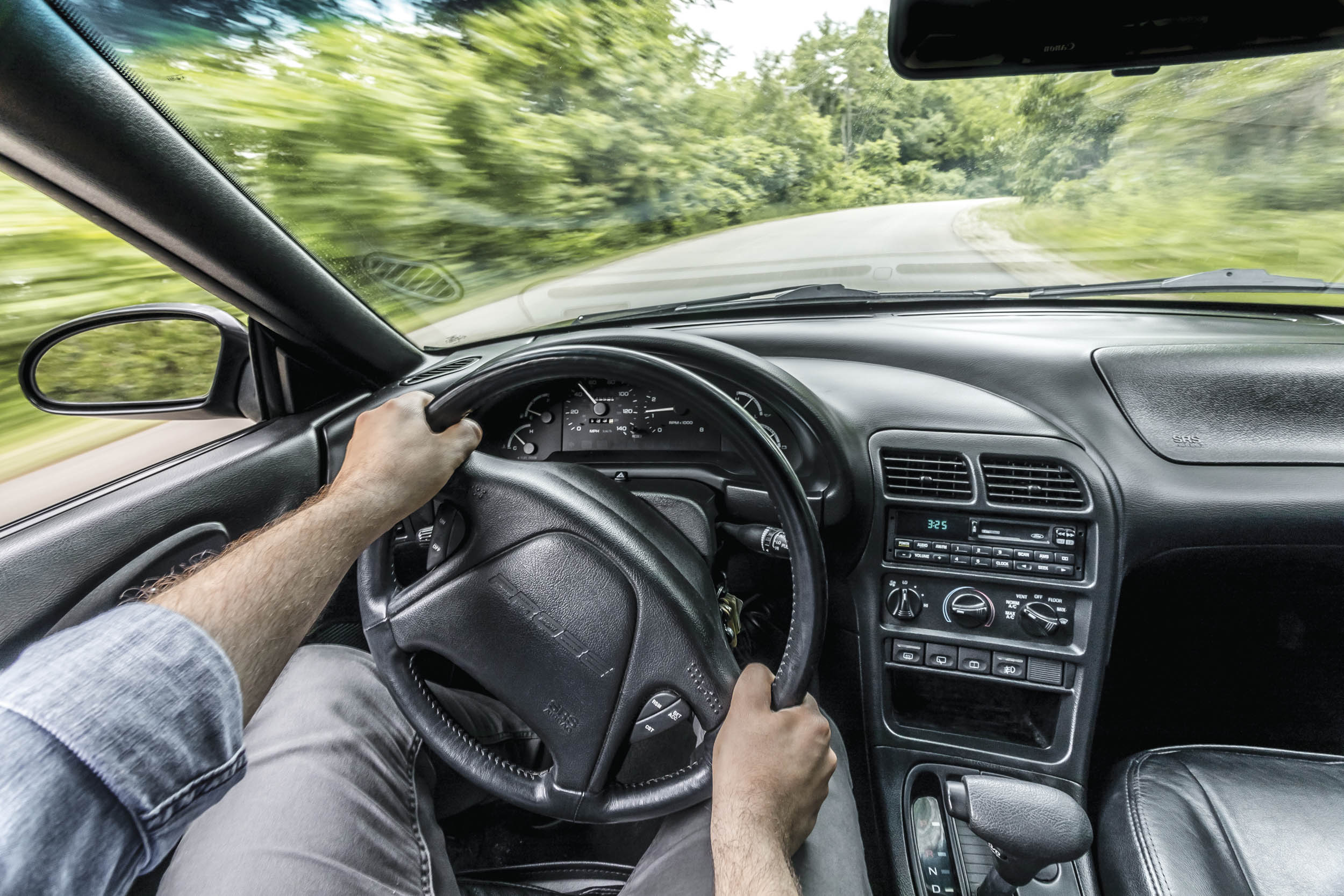The Probe's big windshield and sharp nose make for easy placement in corners, and the bucket seats with firm upper bolsters keep the driver in place. The fourspeed automatic was optional.