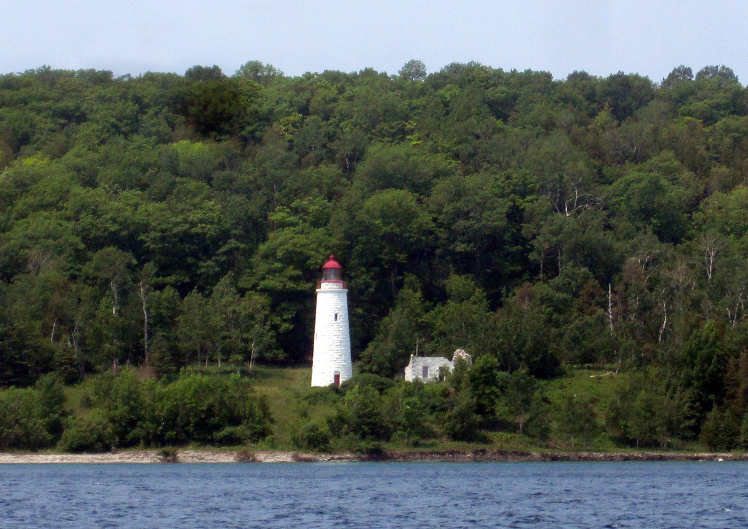 "The MANASOO sank in the middle of the night while try- ing to reach the Griffith Island Lighthouse, one of only six ""imperial"" lights on Georgian Bay, built in 1858 and still in use (although automated) to- day."