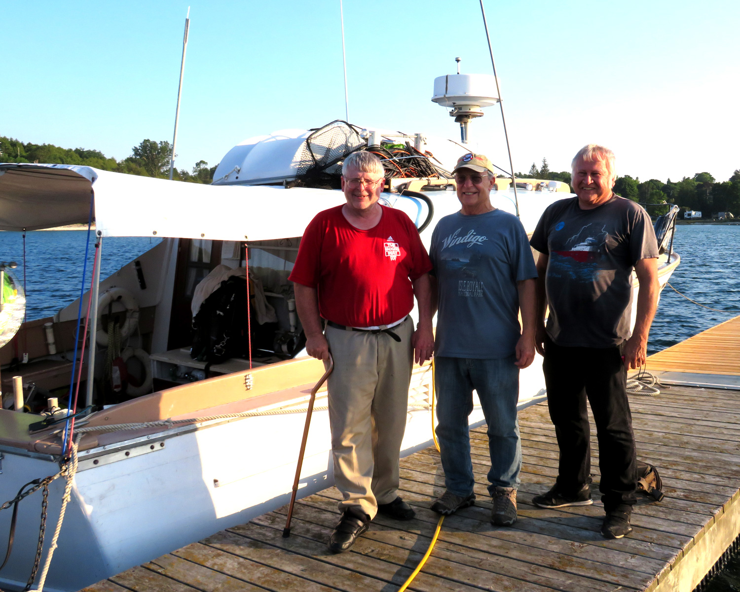 The international wreck hunting team of (left to right) Jerry Eliason, underwater electronics wizard; Ken Merryman, licensee, boat operator and underwater videographer; and Cris Kohl, maritime historian and diver.