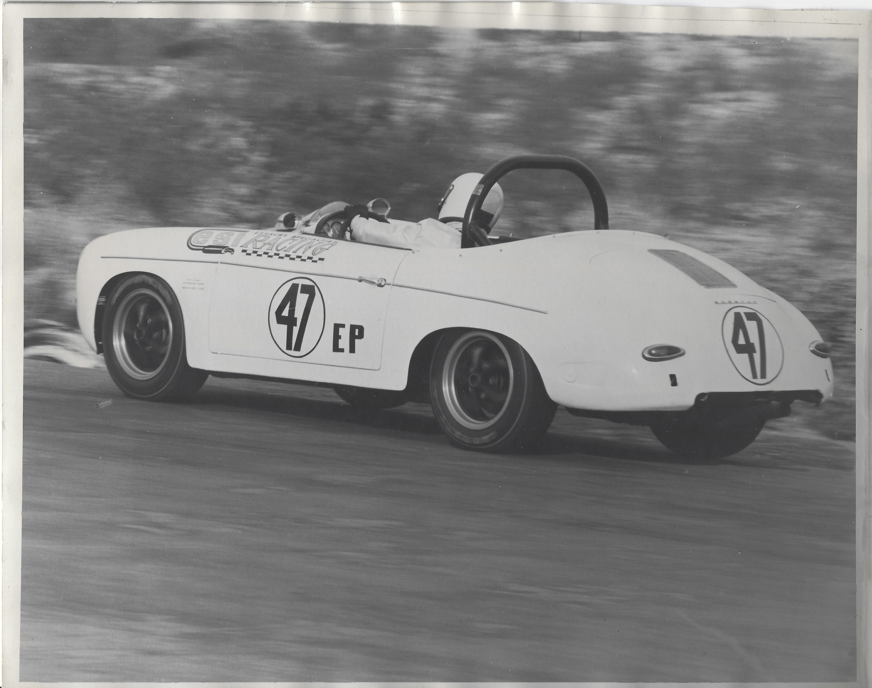 Larry racing a white Speedster in 1966 at the Salt Lake City Autocross competition.