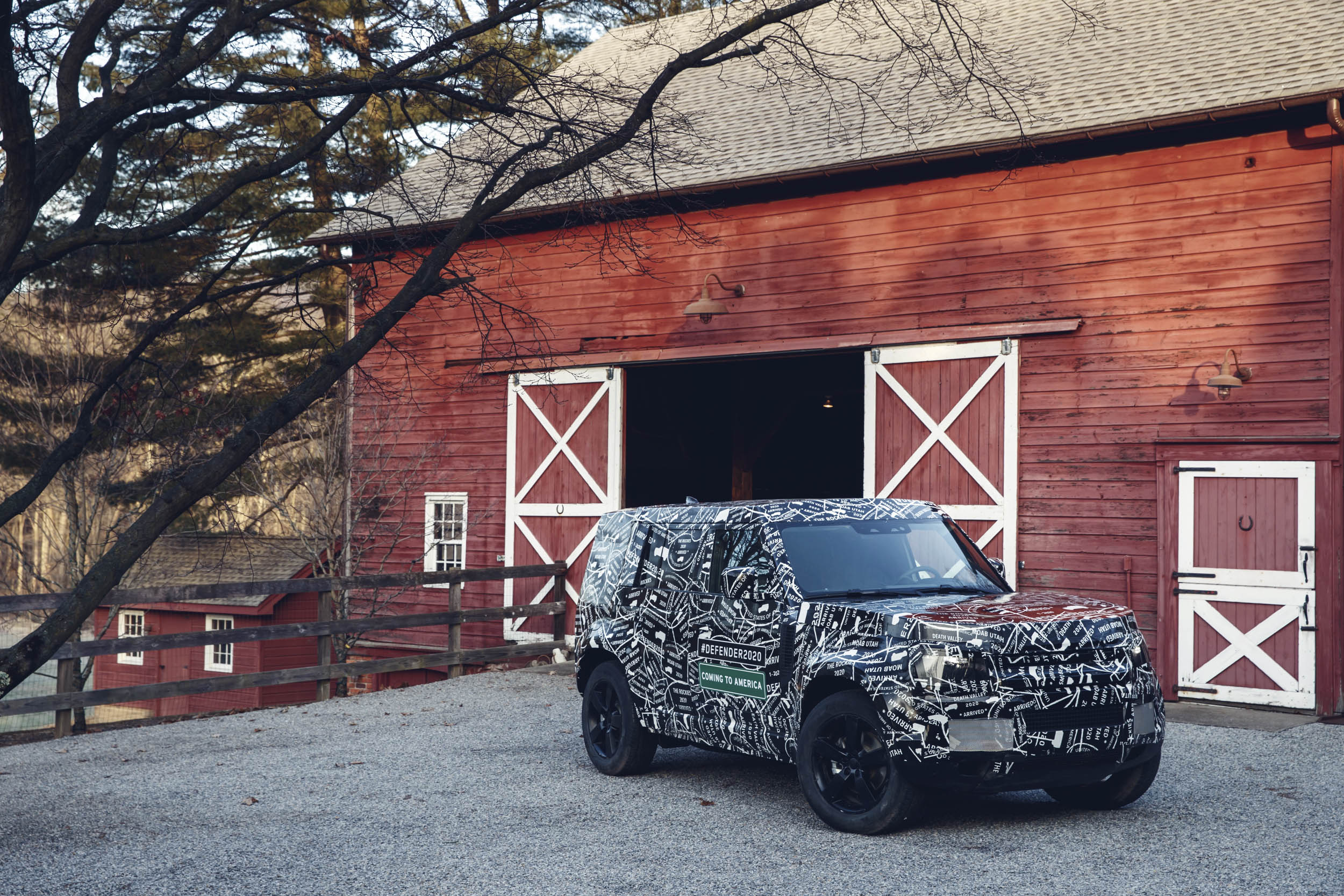 Land Rover Defender in front of a barn