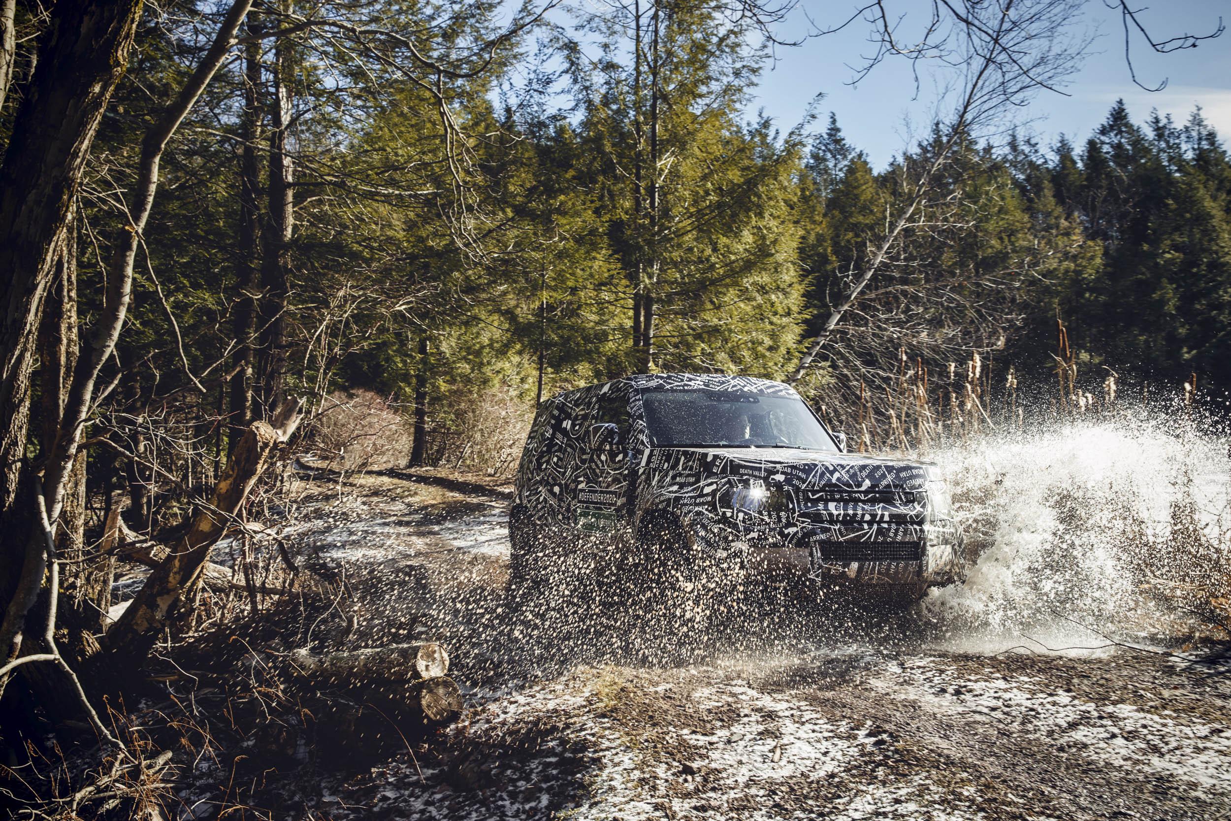 Land Rover splashing through a river