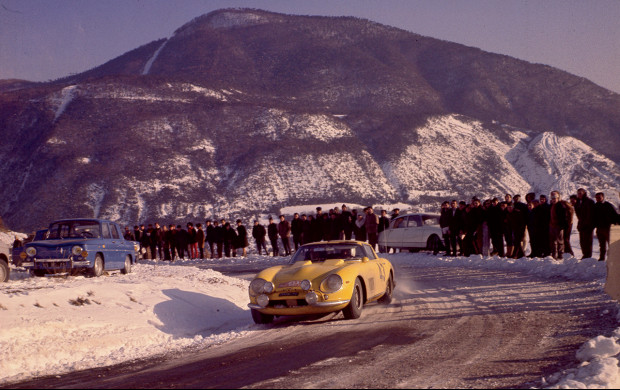 Spectators marvel at the sight of a 12-cylinder Ferrari rally car.