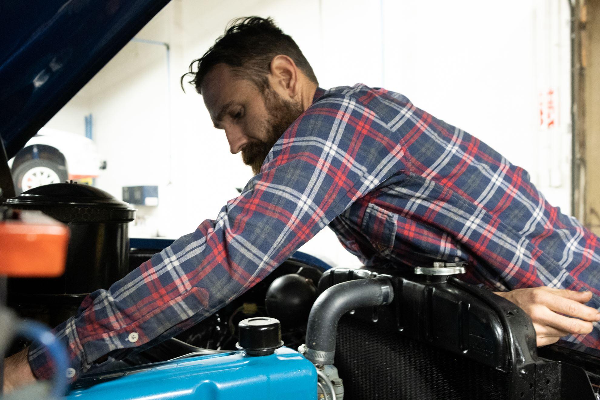 Aaron Kaufman Arclight fab shifting gears working on 55 chevy truck