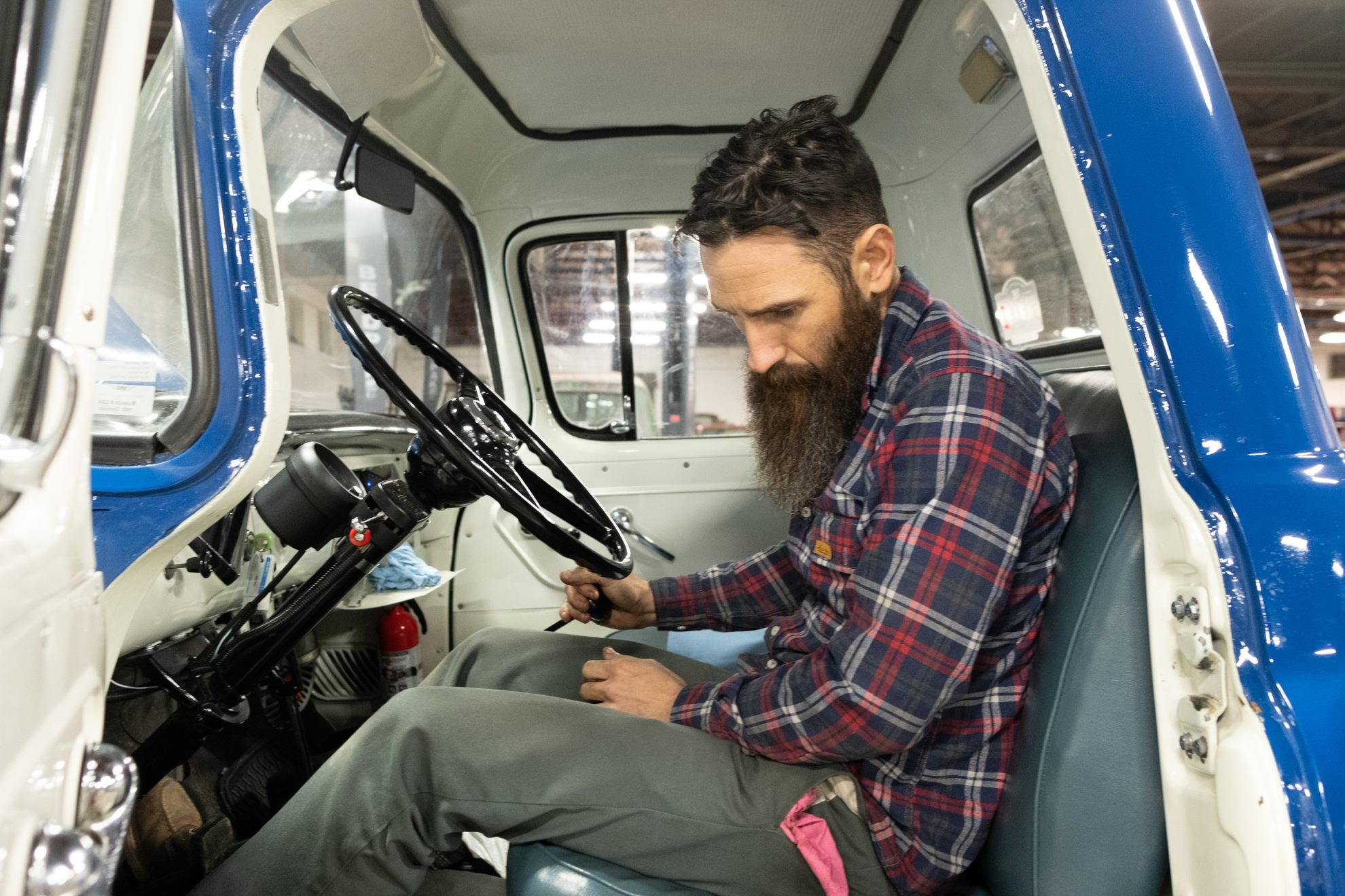 Aaron Kaufman Arclight fab shifting gears sitting in 55 chevy truck