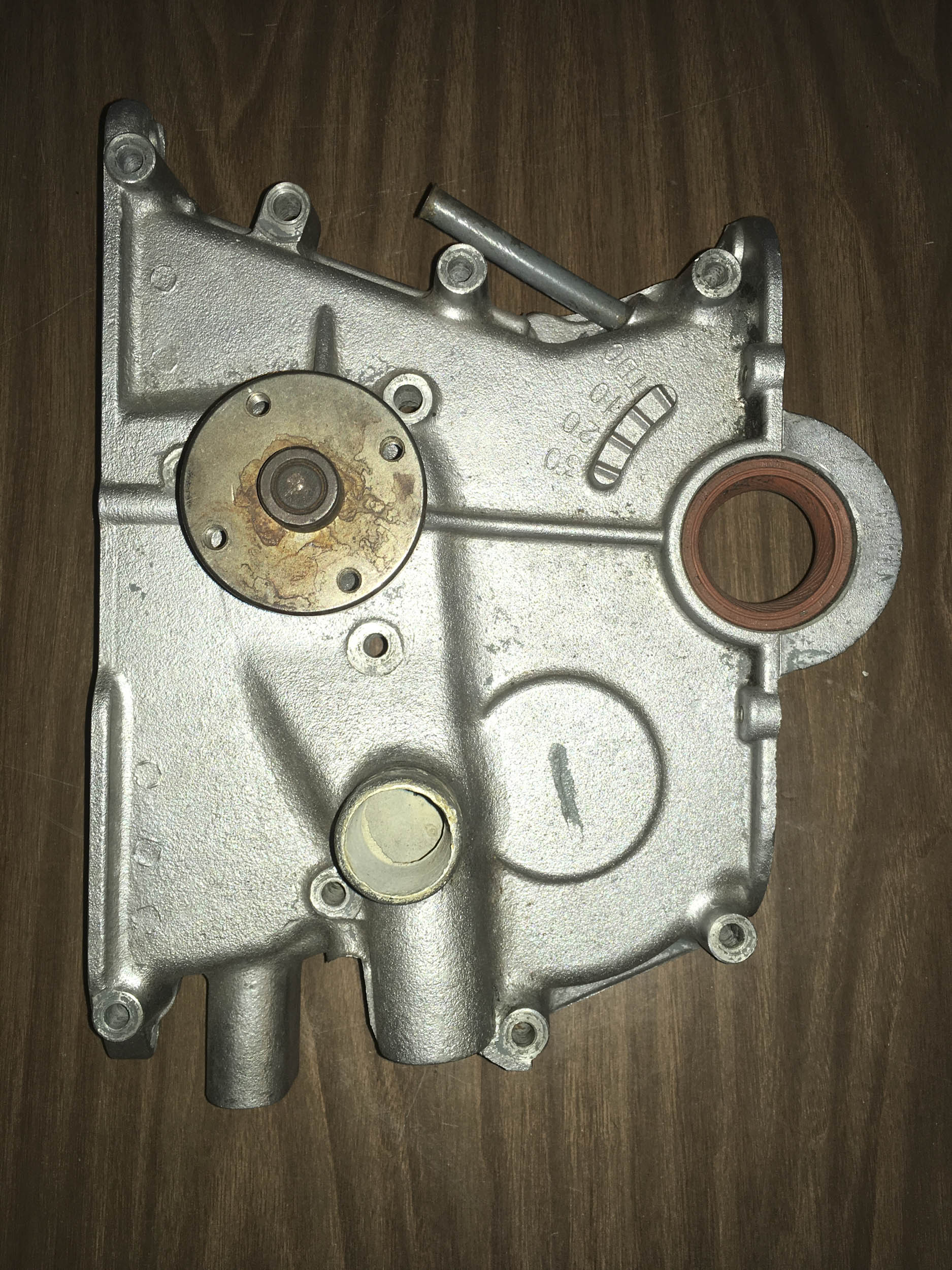 This shows how the water pump on the Lotus-Ford Twin-Cam engine is integrated into the timing cover instead of bolted into it, as it is on most cars.