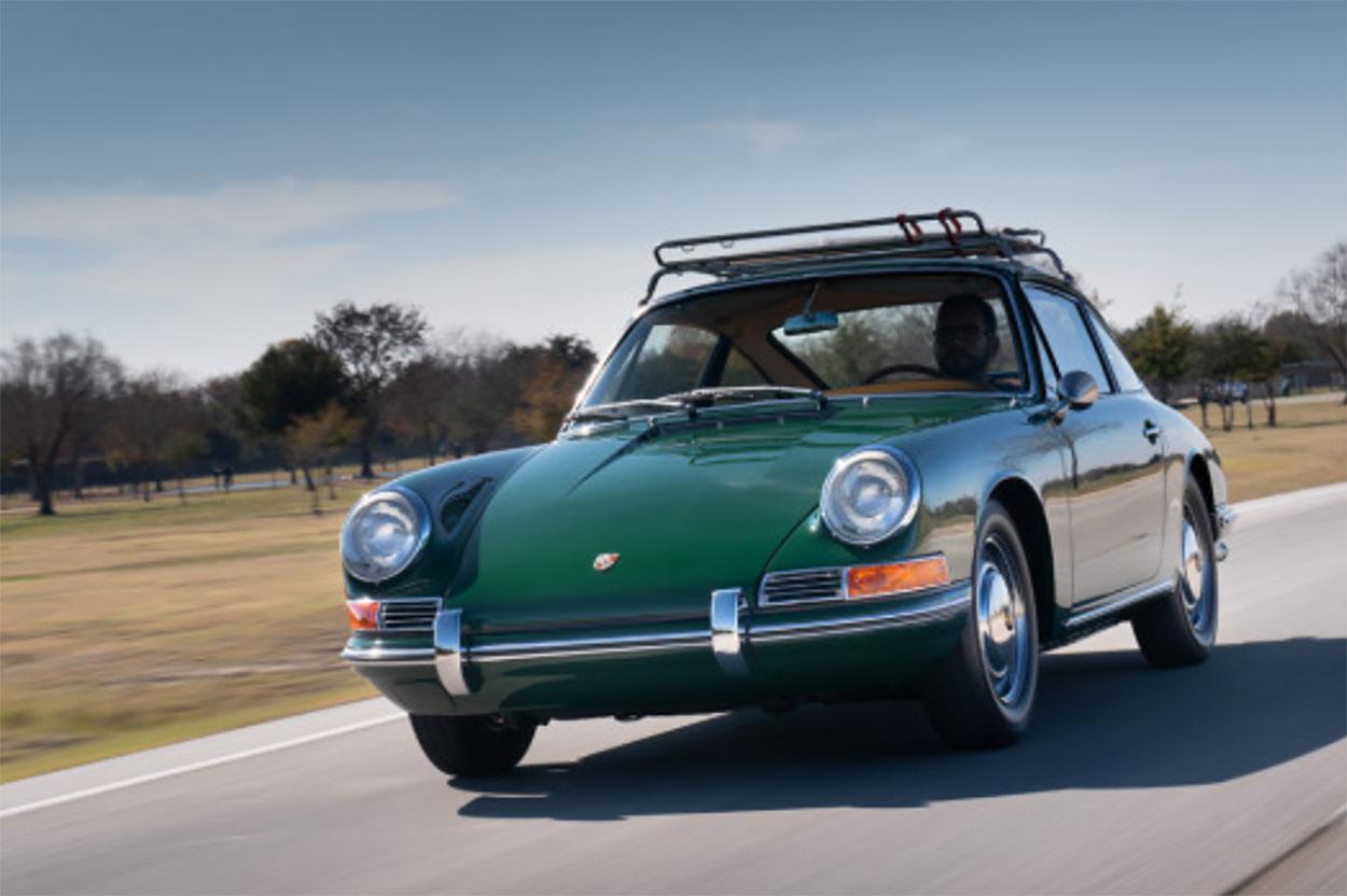 1965 Porsche 911 3/4 driving green