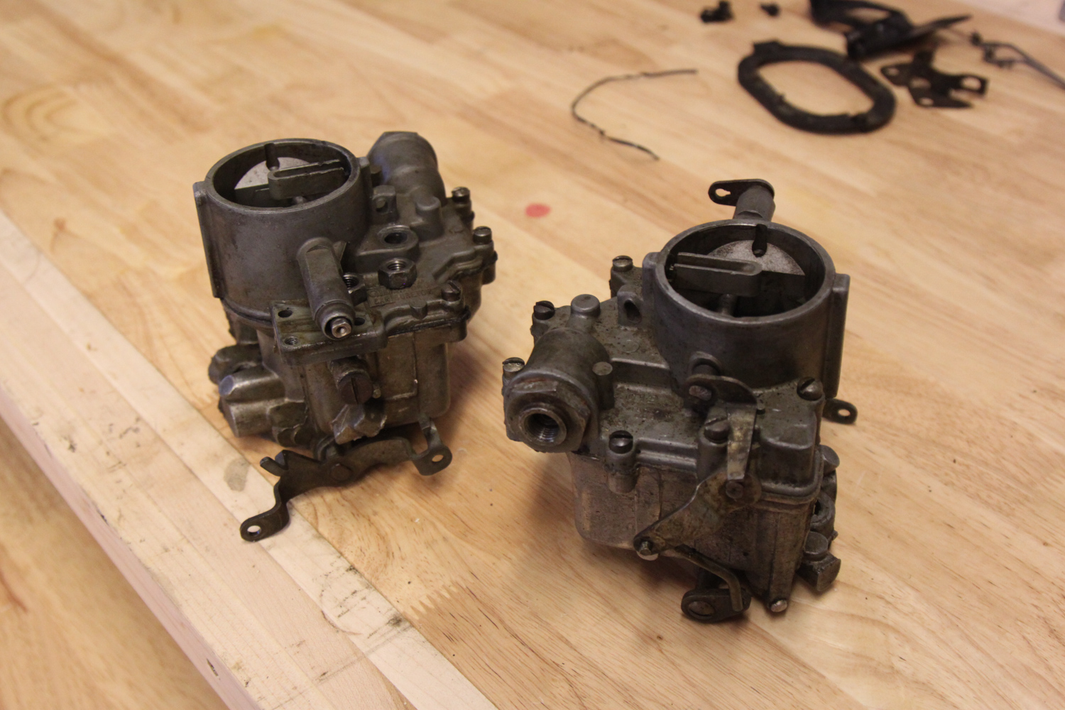 These are the secondary carburetors that were removed to be replaced with units that have an idle circuit.