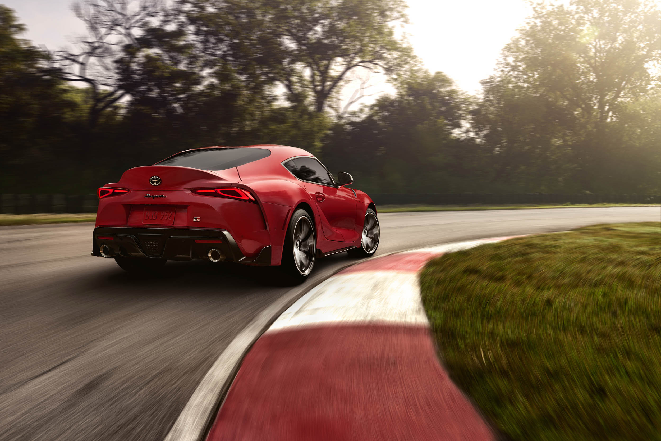 2020 Toyota Supra driving rear 3/4