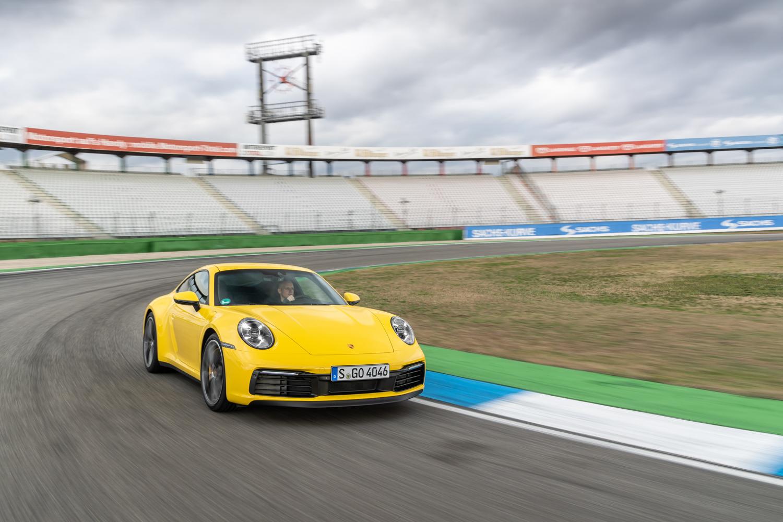 2020 Porsche 911 Carrera S yellow 3/4 track