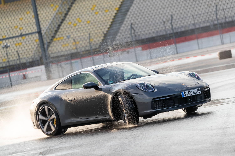 2020 Porsche 911 Carrera S sliding in rain