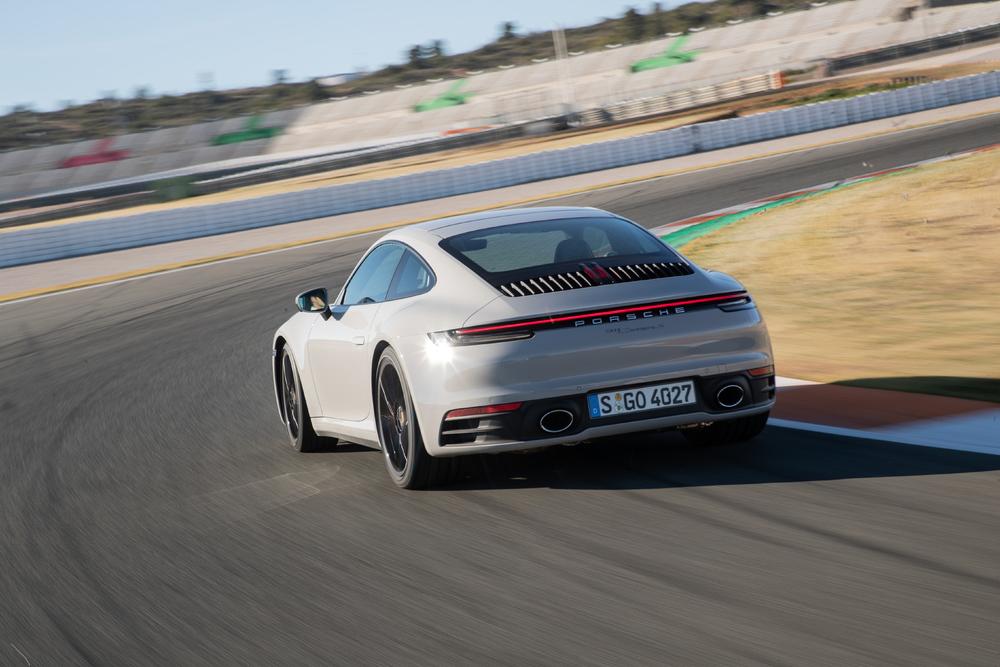 2020 Porsche 911 Carrera S 3/4 rear on track