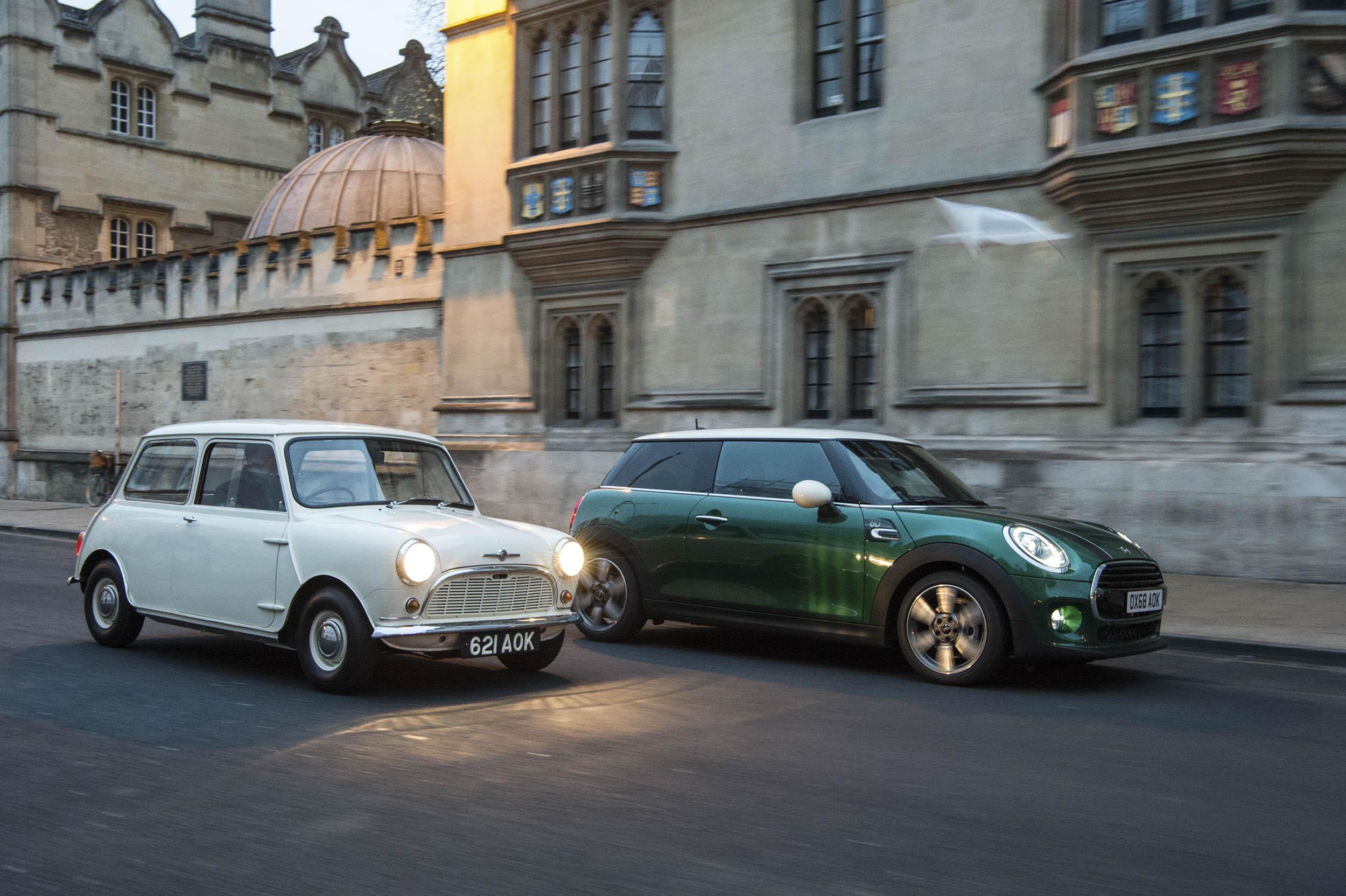 1959 Morris Mini-Minor with 60th anniversary Mini Cooper driving