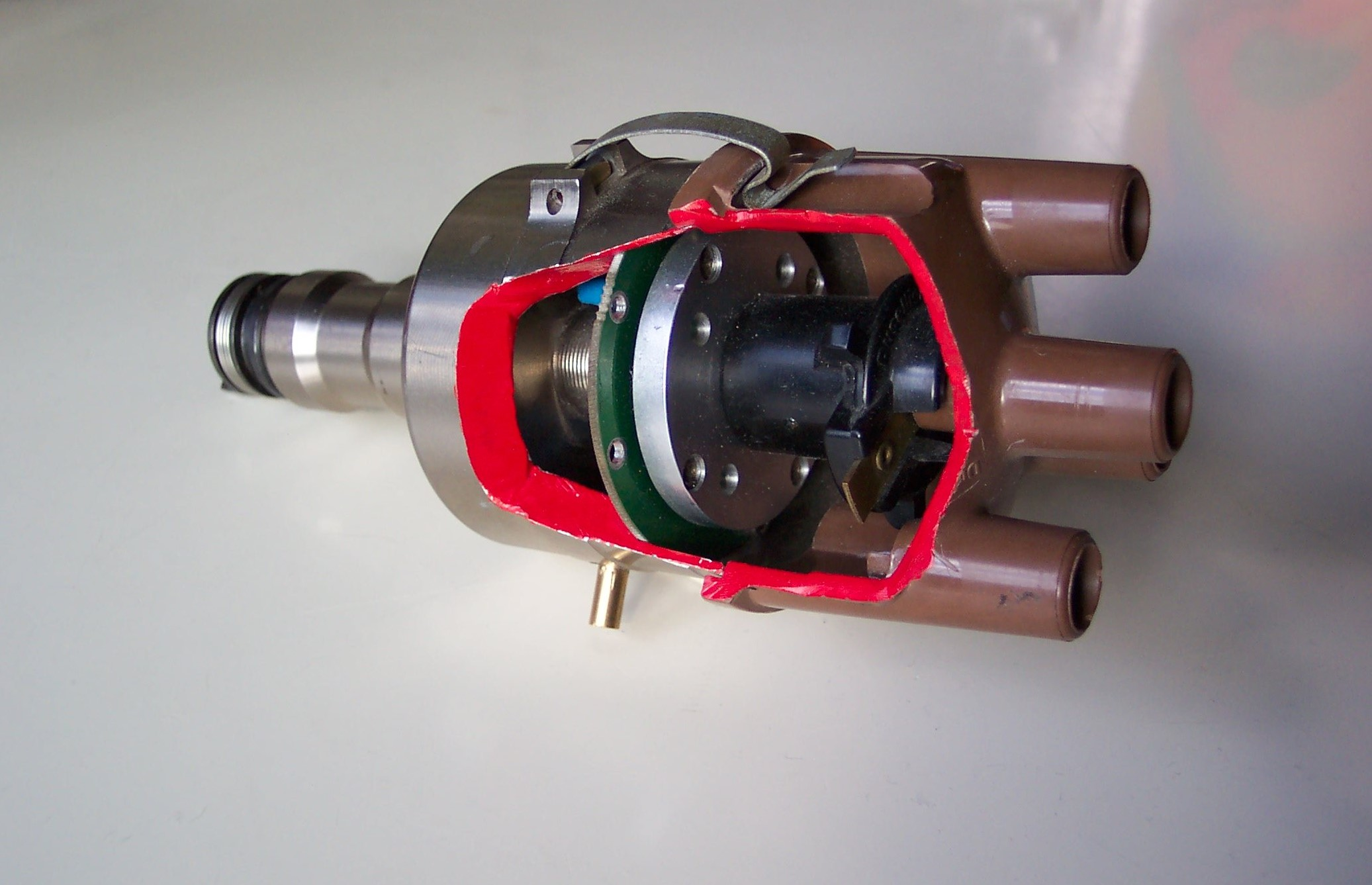 The 123 distributor provides both electronic triggering and electronic spark advance (no more weights and springs).