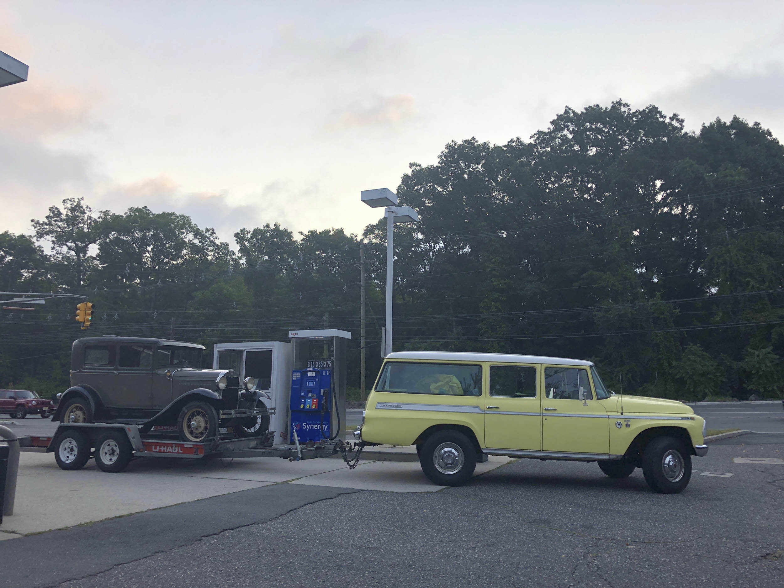 1968 International Travelall towing 1931 Model A Tudor (one of two identical booked for production,) gassing up while headed to set of The Marvelous Mrs. Maisel, Englewood Cliffs, NJ