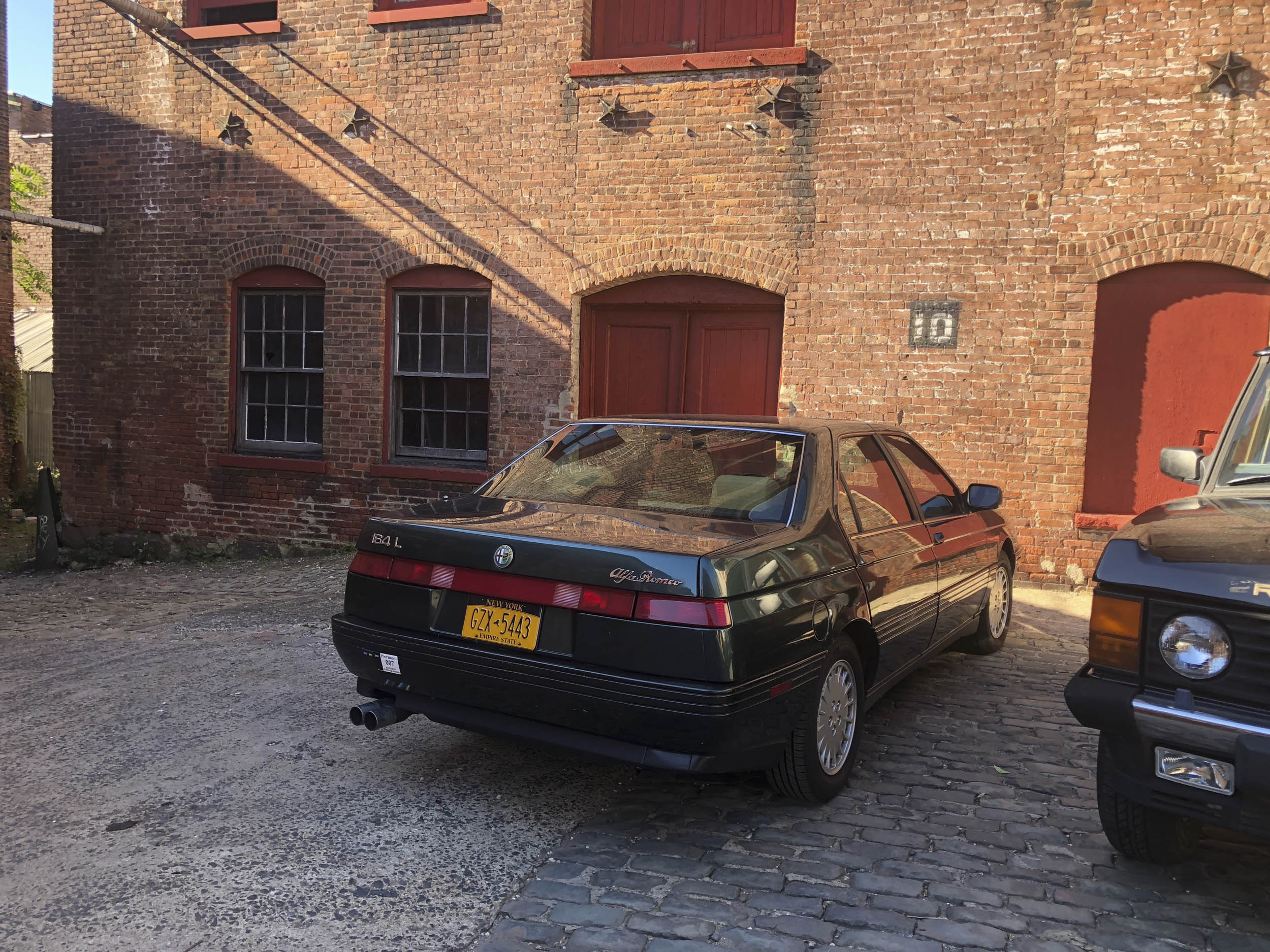 1993 Alfa Romeo 164L on set of Enemy Within, Paterson, NJ, next to Range Rover that will be blown up.