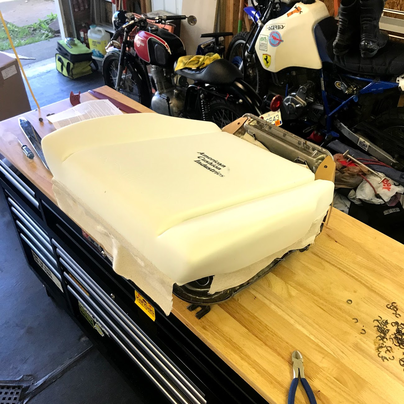 Getting the foam placed correctly before hog ringing it to the seat springs ensures that the cover will fit correctly.