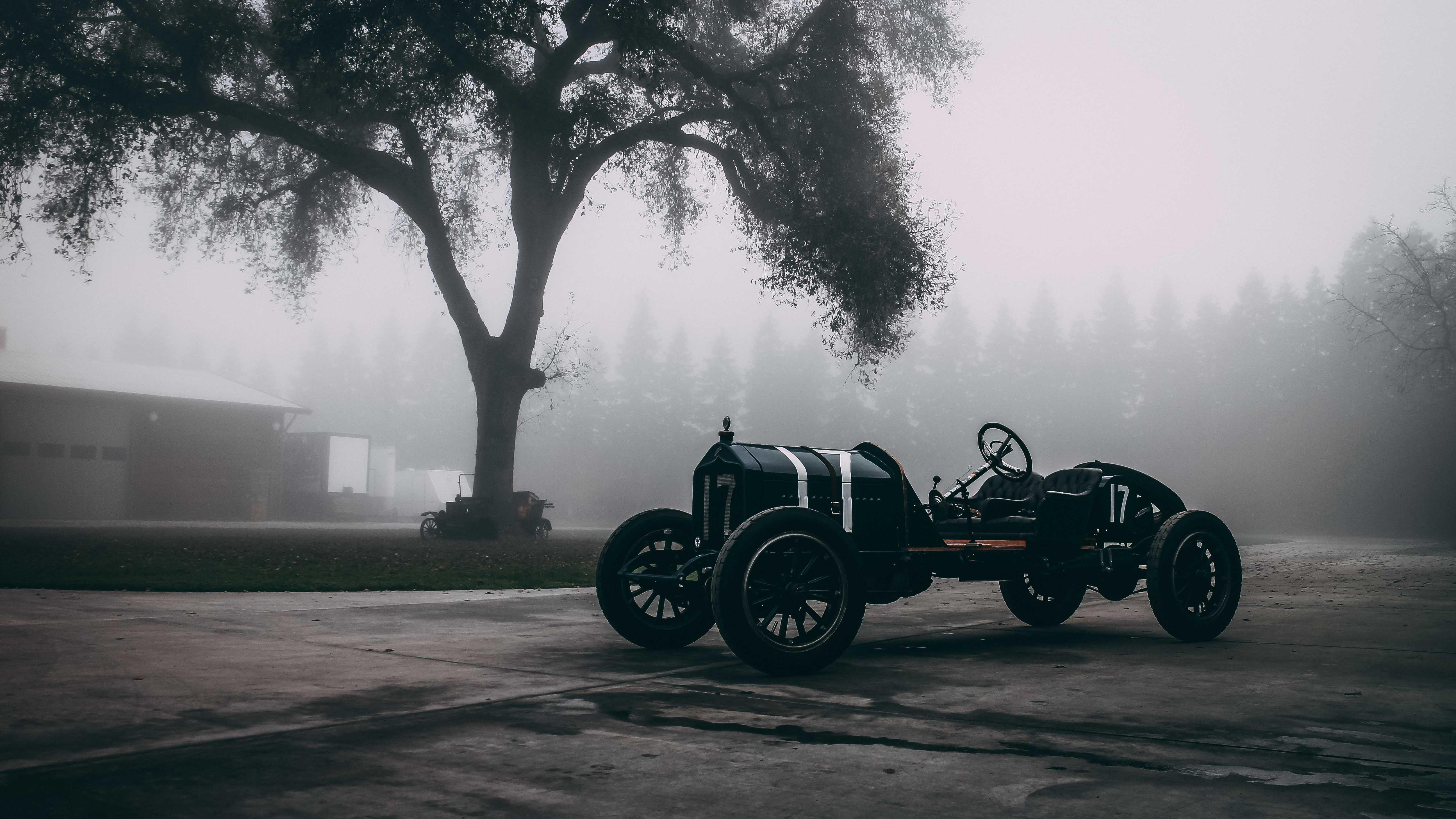 vintage race car in the fog