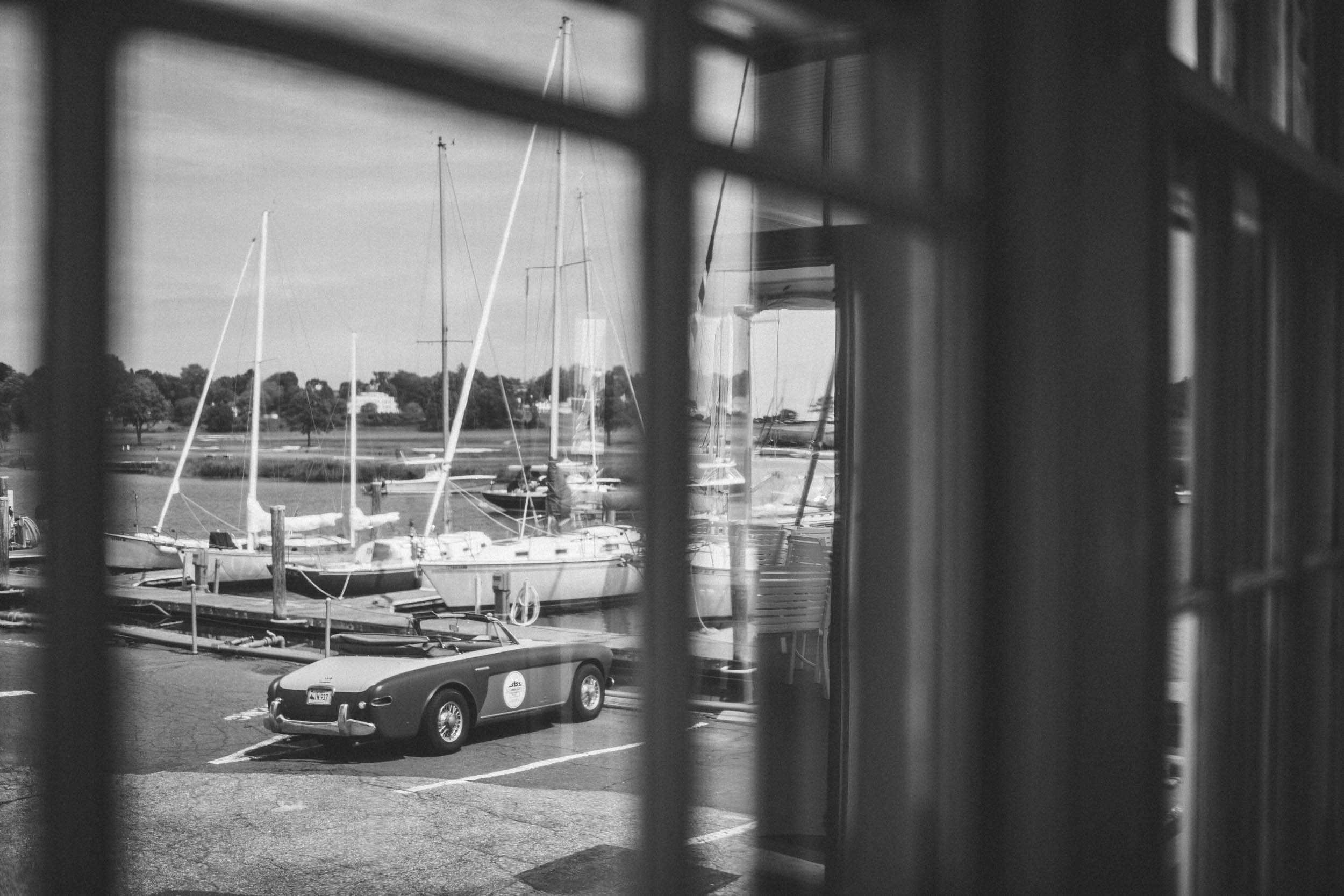 Our borrowed ragtop takes in the view at the Pequot Yacht Club, from which Briggs defended the '58 America's Cup.