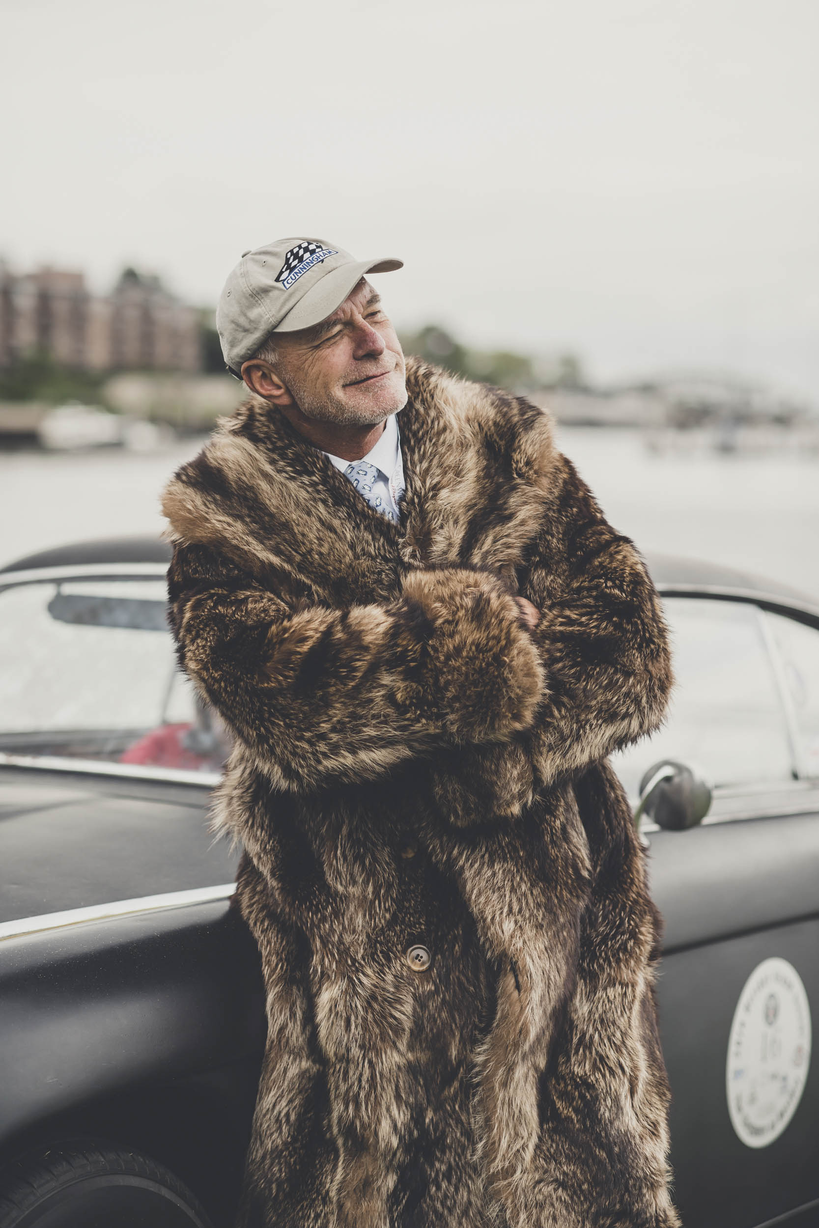 Barn Find bushwhacker Tom Cotter in front of his own C3 coupe (a barn find, of course), wearing a fur coat that once belonged to Briggs Cunningham.